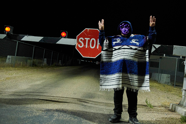 A man poses for photos as attendees gather to  storm  Area 51 at an entrance to the military facility near Rachel, Nevada on September 20, 2019.