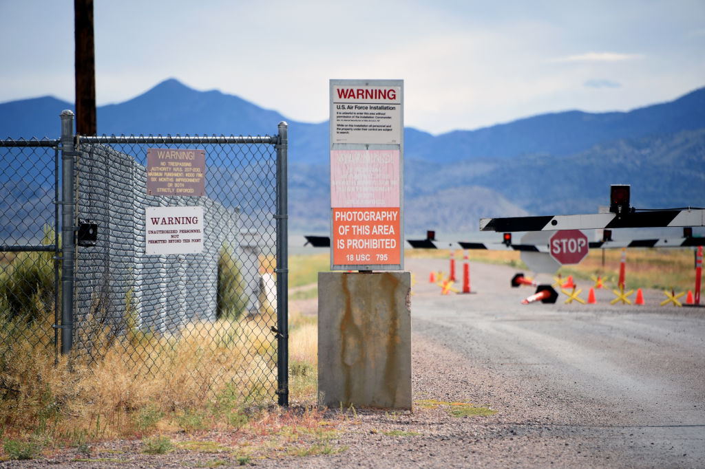 A warning sign is posted at the back gate at the top-secret military installation at the Nevada Test and Training Range known as Area 51 on July 22, 2019 near Rachel, Nevada. A Facebook event entitled,  Storm Area 51, They Can't Stop All of Us,  which the author stated was meant as a joke, calls for people to storm the highly classified U.S. Air Force facility on September 20, 2019, to address a conspiracy theory that the U.S. government is conducting tests with space aliens.  (Photo by David Becker/Getty Images)