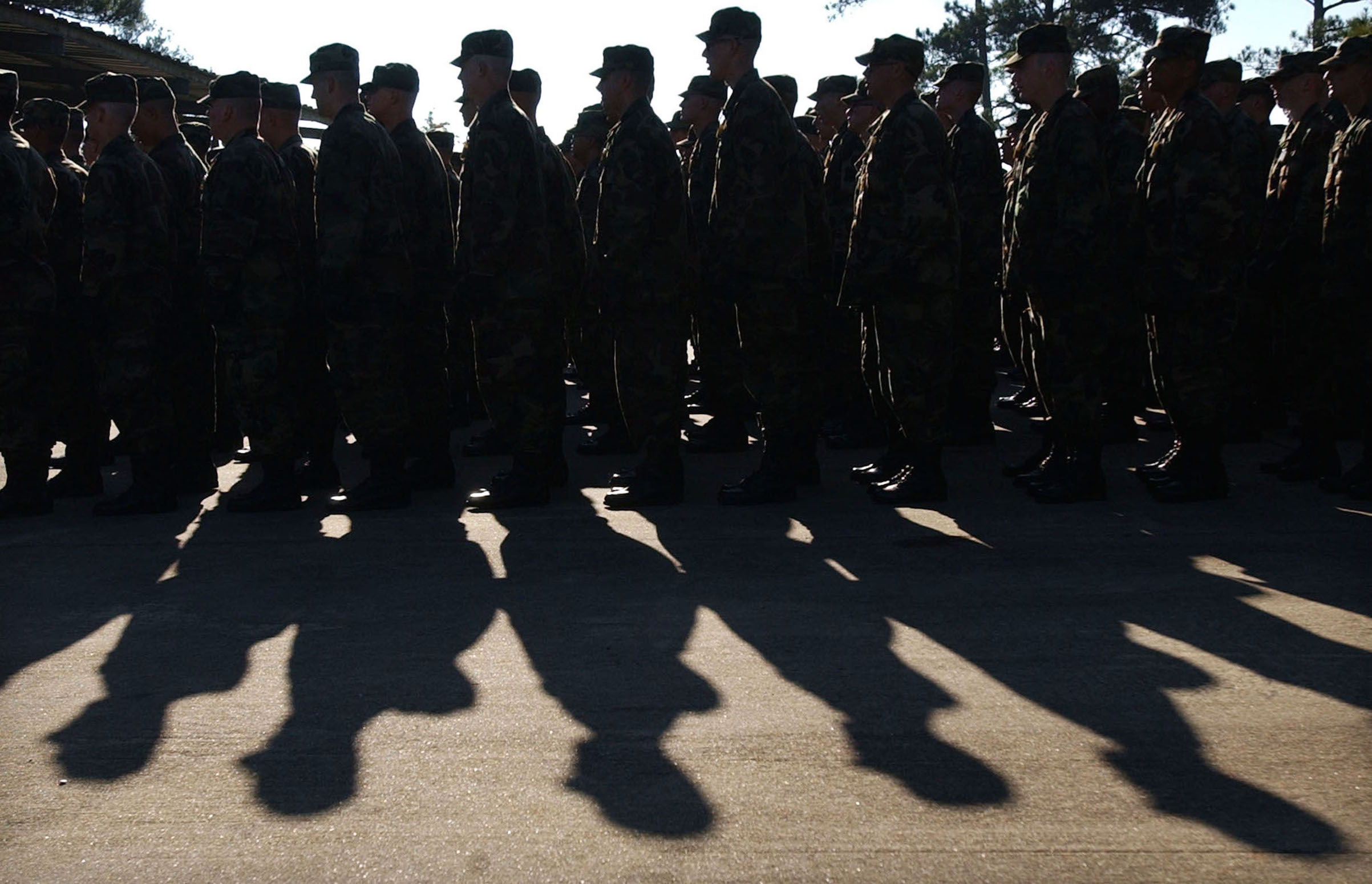 U.S. Soldiers with Delta Company line up to take part in morning team development exercises Nov. 7, 2002 in Fort Benning, Ga. Over 24,000 soldiers every year go through U.S. Army basic training at Fort Benning.