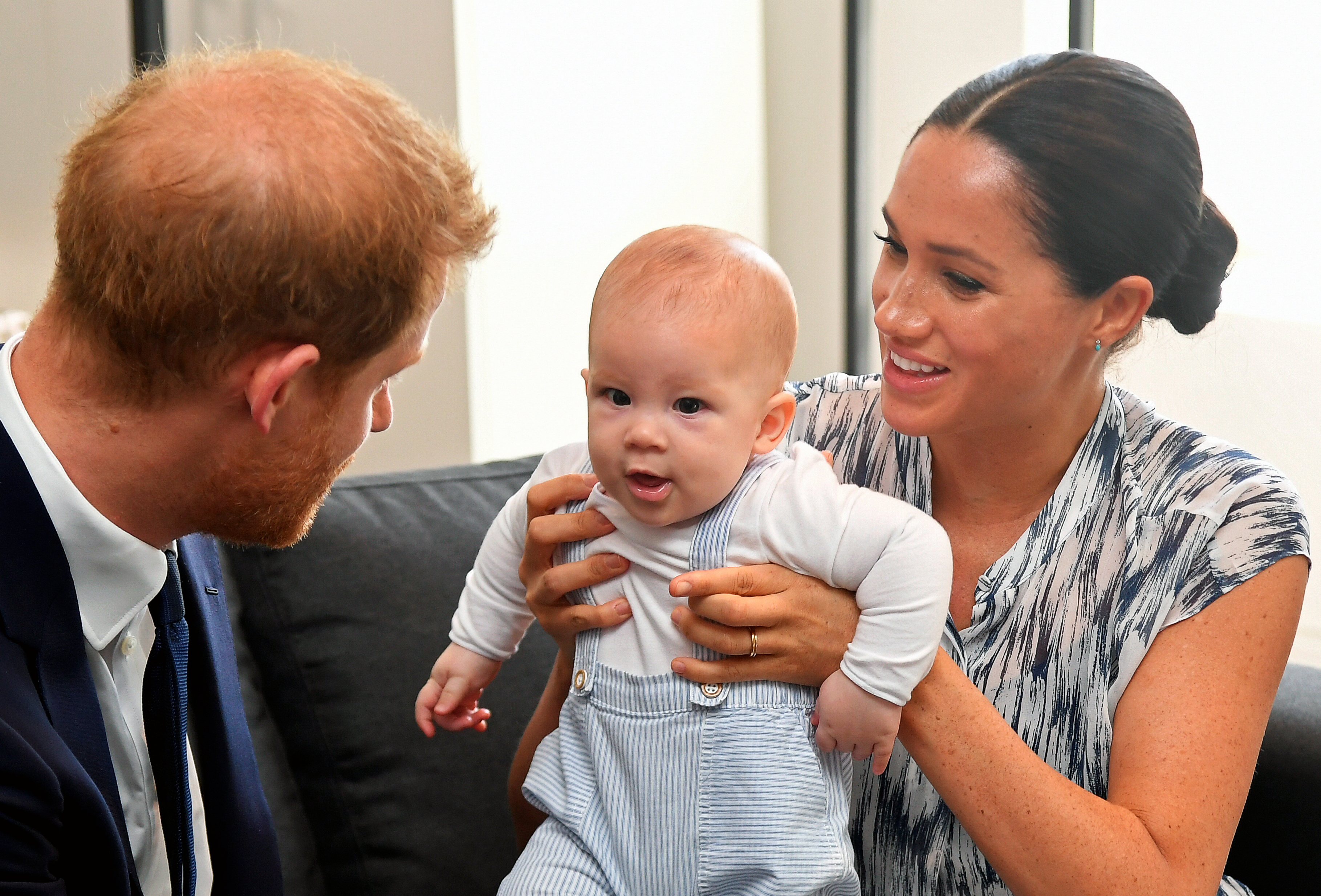 Prince Harry, Duke of Sussex and Meghan, Duchess of Sussex tend to their baby son Archie Mountbatten-Windsor at a meeting with Archbishop Desmond Tutu on September 25, 2019 in Cape Town, South Africa.