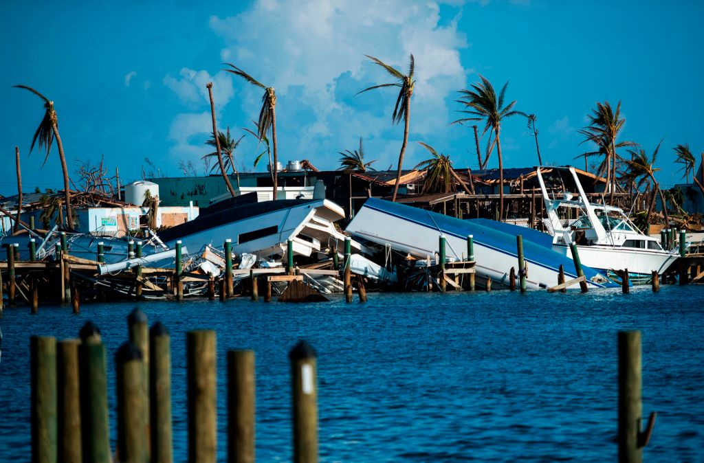 Destroyed boats are pushed up against the pier in the aftermath of Hurricane Dorian in Treasure Cay on Abaco island, Bahamas, on Sept. 11, 2019.