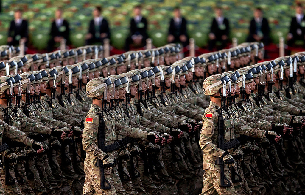Chinese soldiers march past Tiananmen Square before a military parade on September 3, 2015 in Beijing, China.