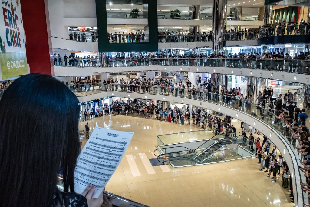 Protesters sing songs and shout slogans as they gather at Cityplaza shopping center after business hours in Hong Kong on Sep. 9, 2019.