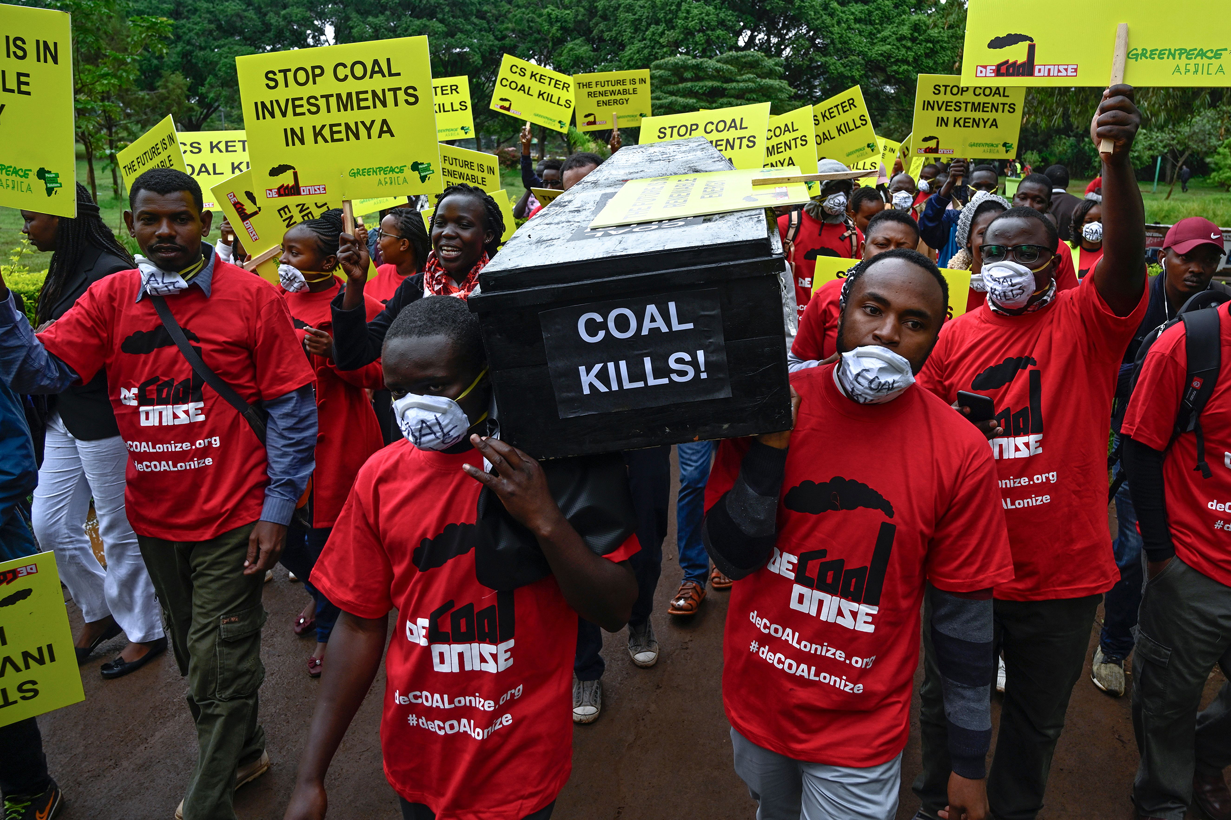 Environmental activists hold a coffin reading  coal kills  as they demonstrate in Nairobi against the construction of a coal power plant in Lamu on Kenya's coast, on June 12, 2019.