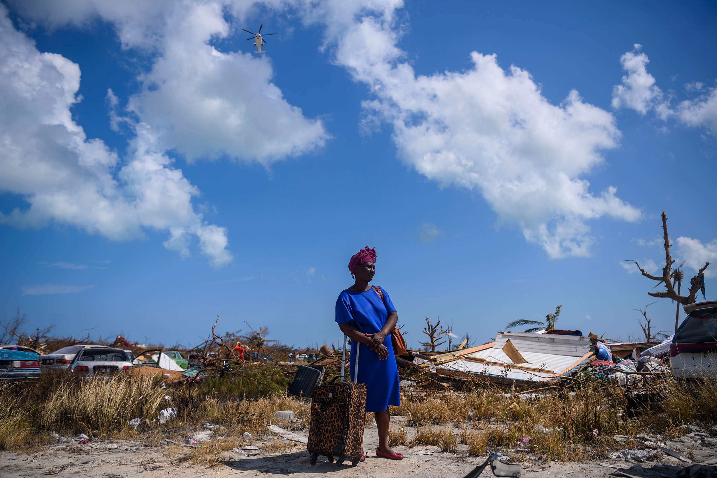 Dejani Louistan, who was displaced by Hurricane Dorian, stands with the only belongings she managed to salvage amid the destruction left in the Mudd neighborhood of Marsh Harbour, Bahamas on September 7, 2019.