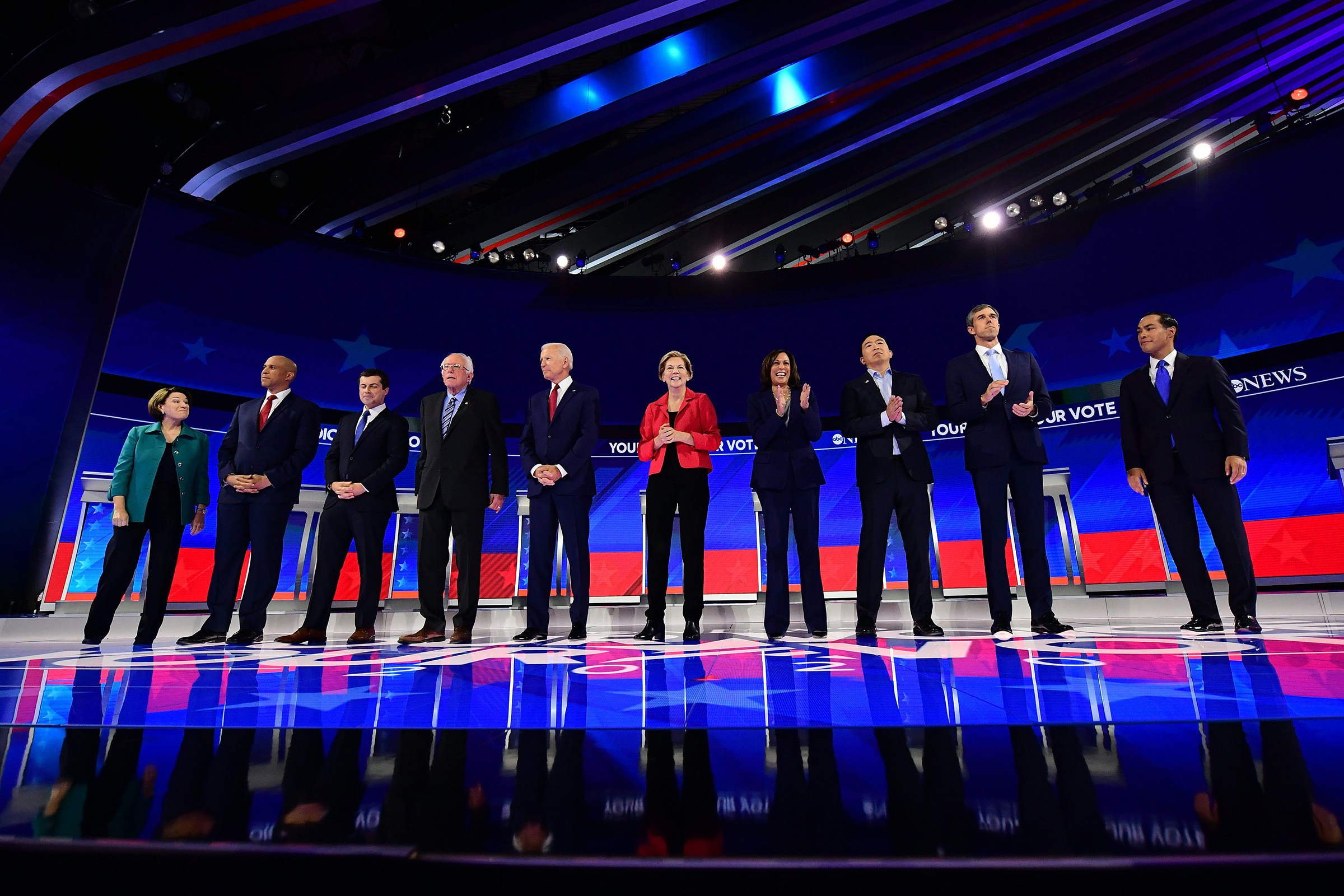 Democratic presidential hopefuls (L-R) Senator of New Jersey Cory Booker, Mayor of South Bend, Indiana, Pete Buttigieg, Senator of Vermont Bernie Sanders, Former Vice President Joe Biden, Senator of Massachusetts Elizabeth Warren, Senator of California Kamala Harris, Tech entrepreneur Andrew Yang, Former Representative of Texas Beto O'Rourke and Former housing secretary Julian Castro stand onstage ahead of the third Democratic primary debate of the 2020 presidential campaign season at Texas Southern University in Houston, Texas on September 12, 2019.