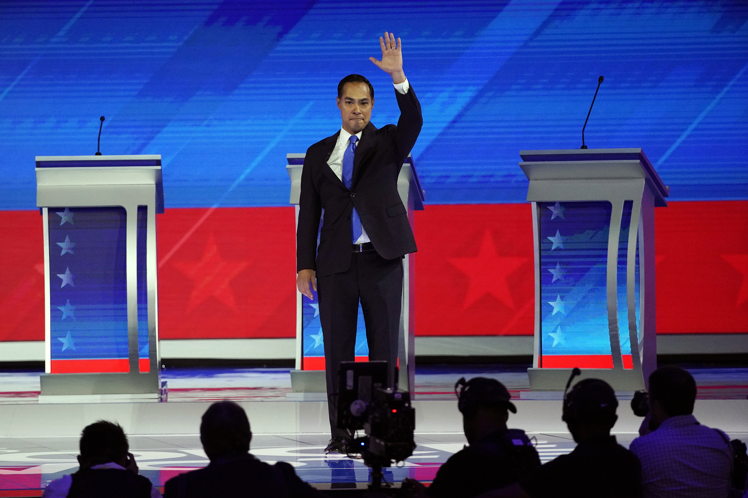 Former Housing and Urban Development Secretary Julian Castro waves as he takes the stage Thursday, Sept. 12, 2019, during a Democratic presidential primary debate at Texas Southern University in Houston.
