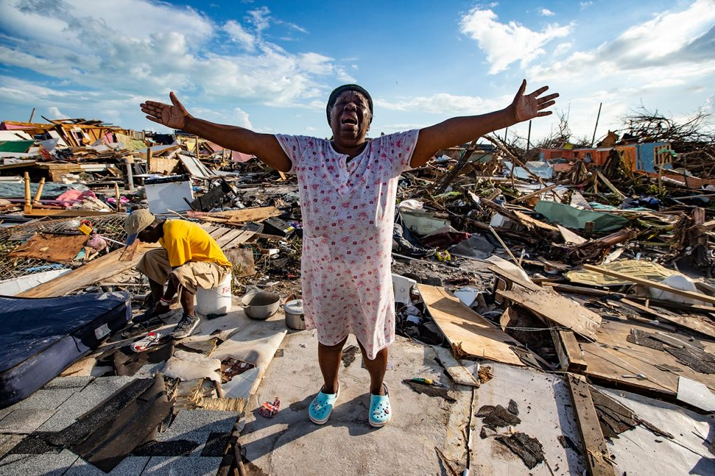 Aliana Alexis of Haiti stands on the concrete slab of what is left of her home after destruction from Hurricane Dorian in an area called  The Mudd  at Marsh Harbour in Great Abaco Island, Bahamas on Thursday, Sept. 5, 2019.