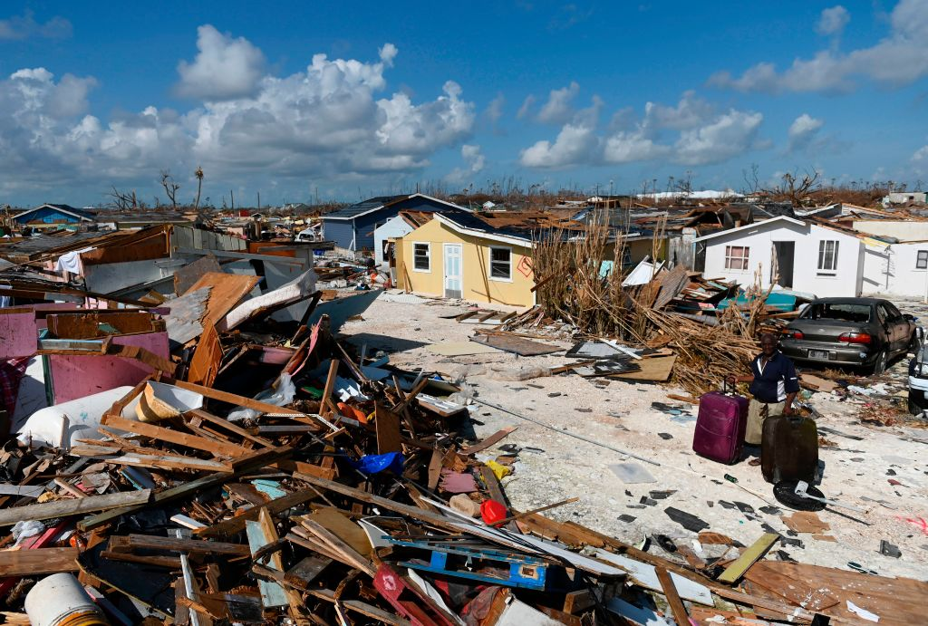 A man collects his belongings before going to the port in Marsh Harbour, Bahamas to evacuate on September 10, 2019.