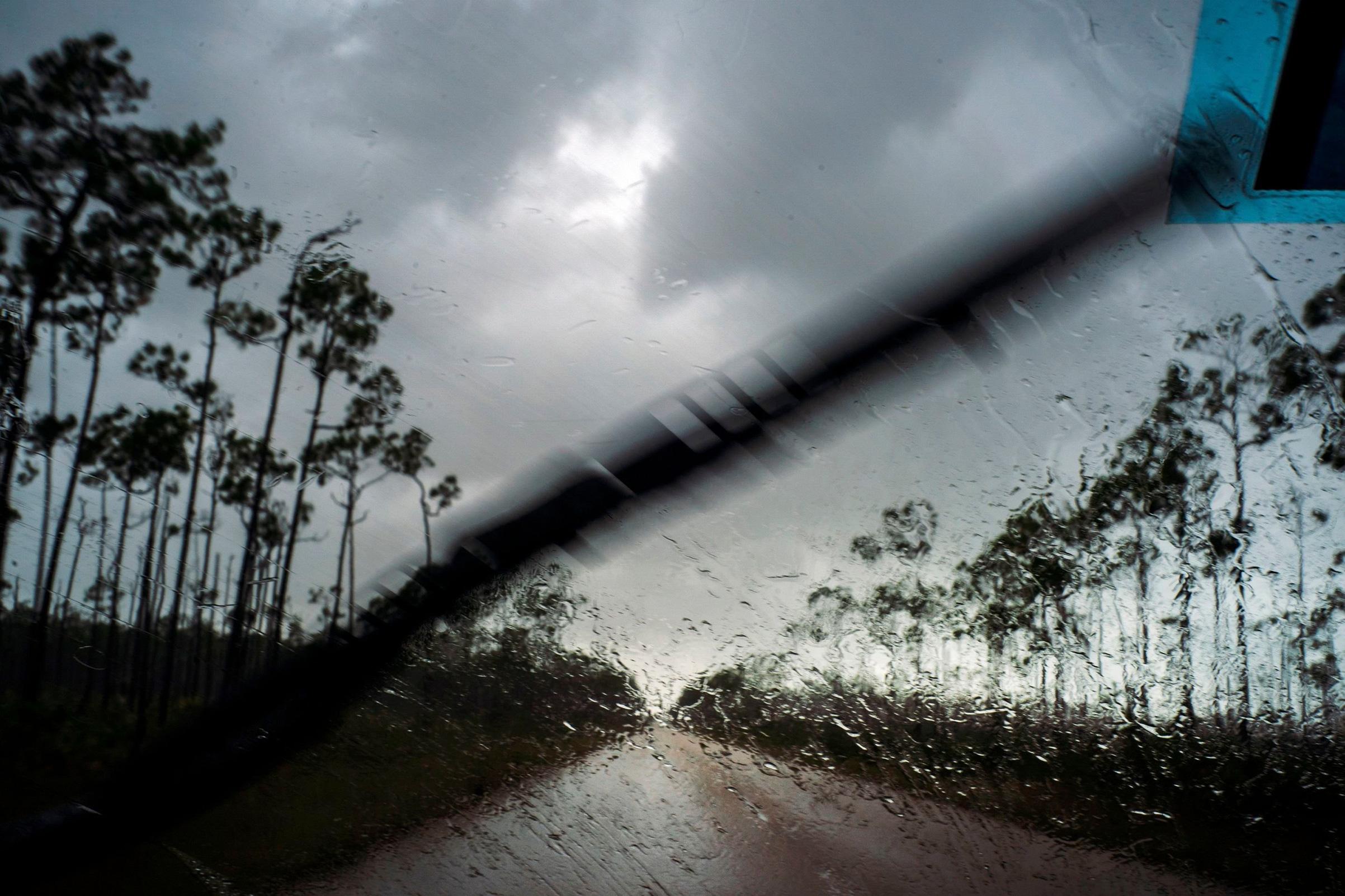 A car returns to the capital before the arrival of Hurricane Dorian in Freeport, Grand Bahama, Bahamas, Sept. 1, 2019.