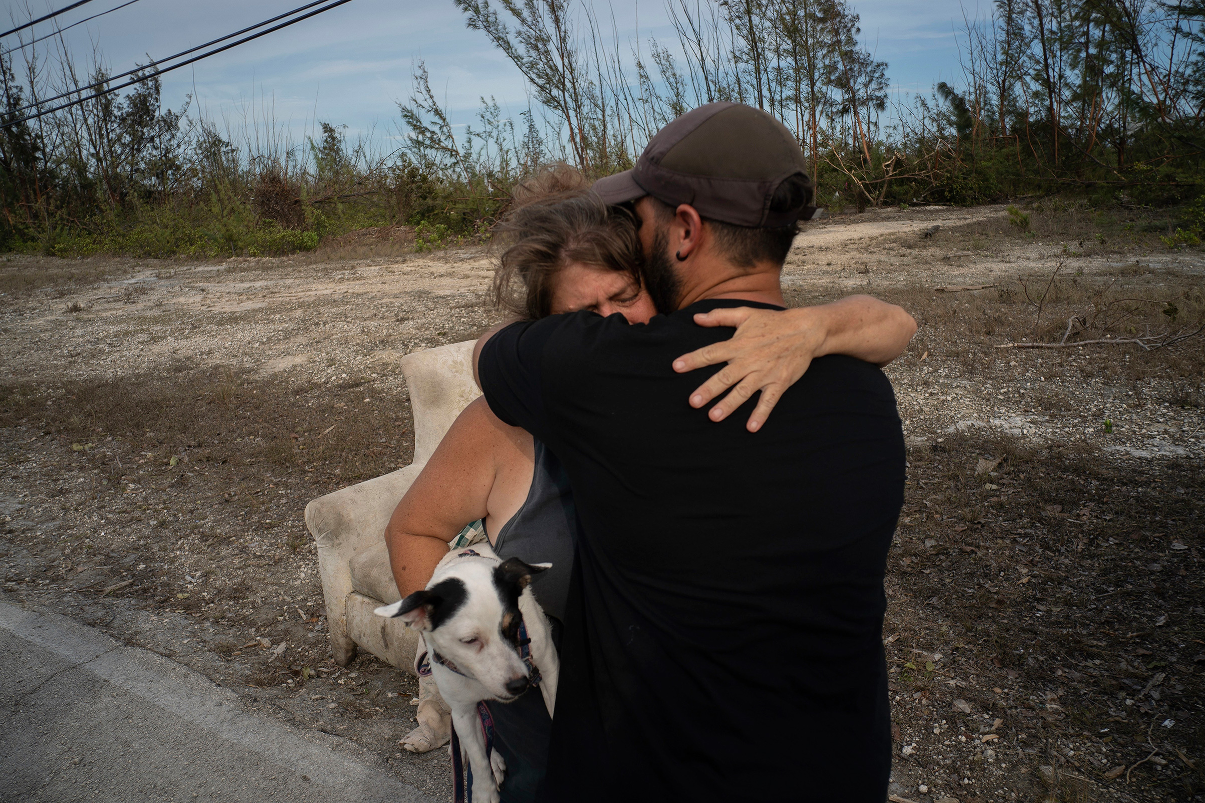 Sissel Mosvold embraces a volunteer who helped rescue her mother from her home when it was flooded by the waters of Hurricane Dorian, in the outskirts of Freeport, Bahamas, Sept. 4, 2019.