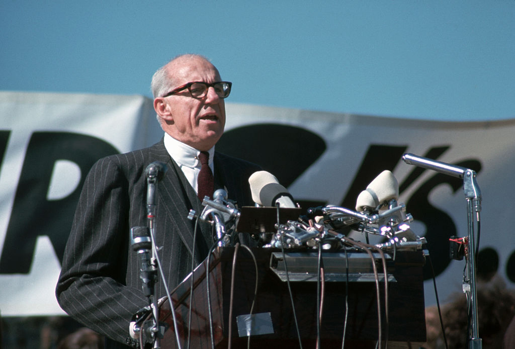 Dr. Benjamin Spock speaks at a 1967 anti-Vietnam rally in Washington, D.C. The famous pediatrician resigned a professorship that year in order to devote his efforts to the antiwar cause and to the pursuit of world peace.