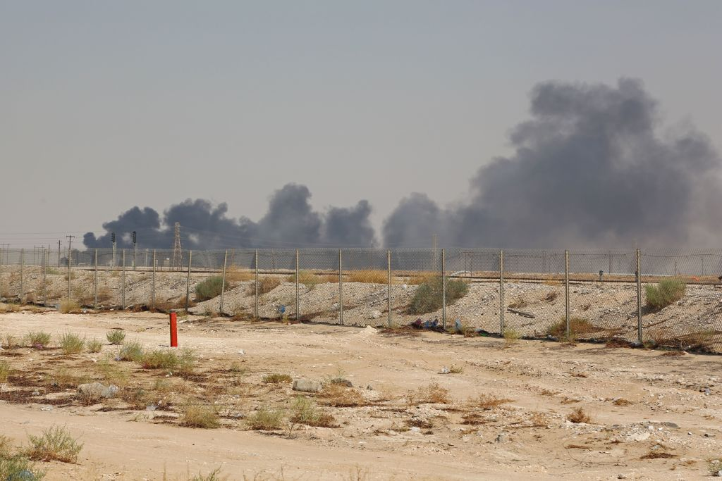Smoke billows from an Aramco oil facility in Abqaiq about 60km (37 miles) southwest of Dhahran in Saudi Arabia's eastern province on Sept. 14, 2019.