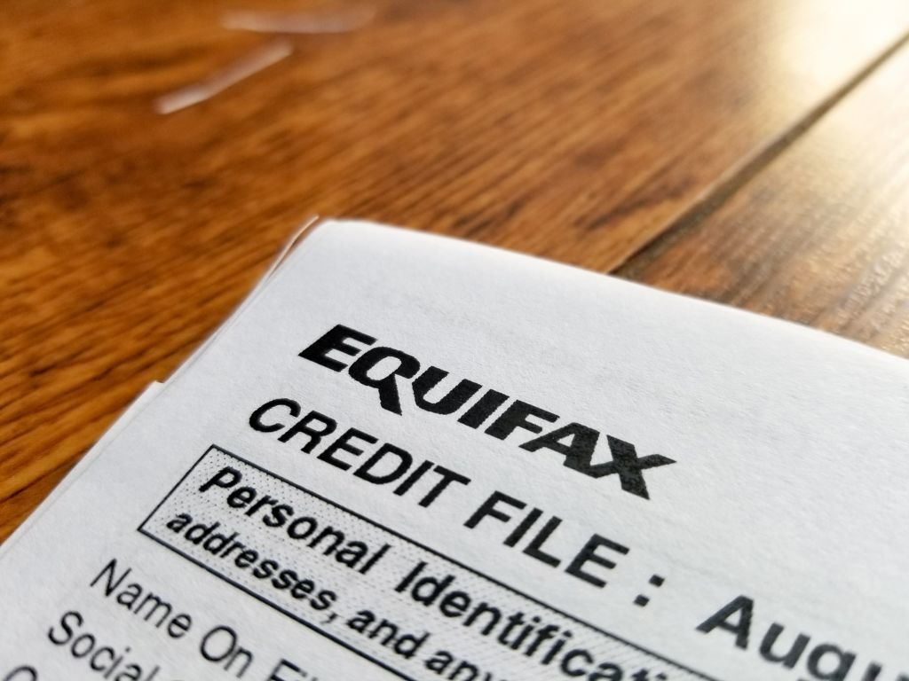 Close-up of the upper corner of a consumer credit report from the credit bureau Equifax.