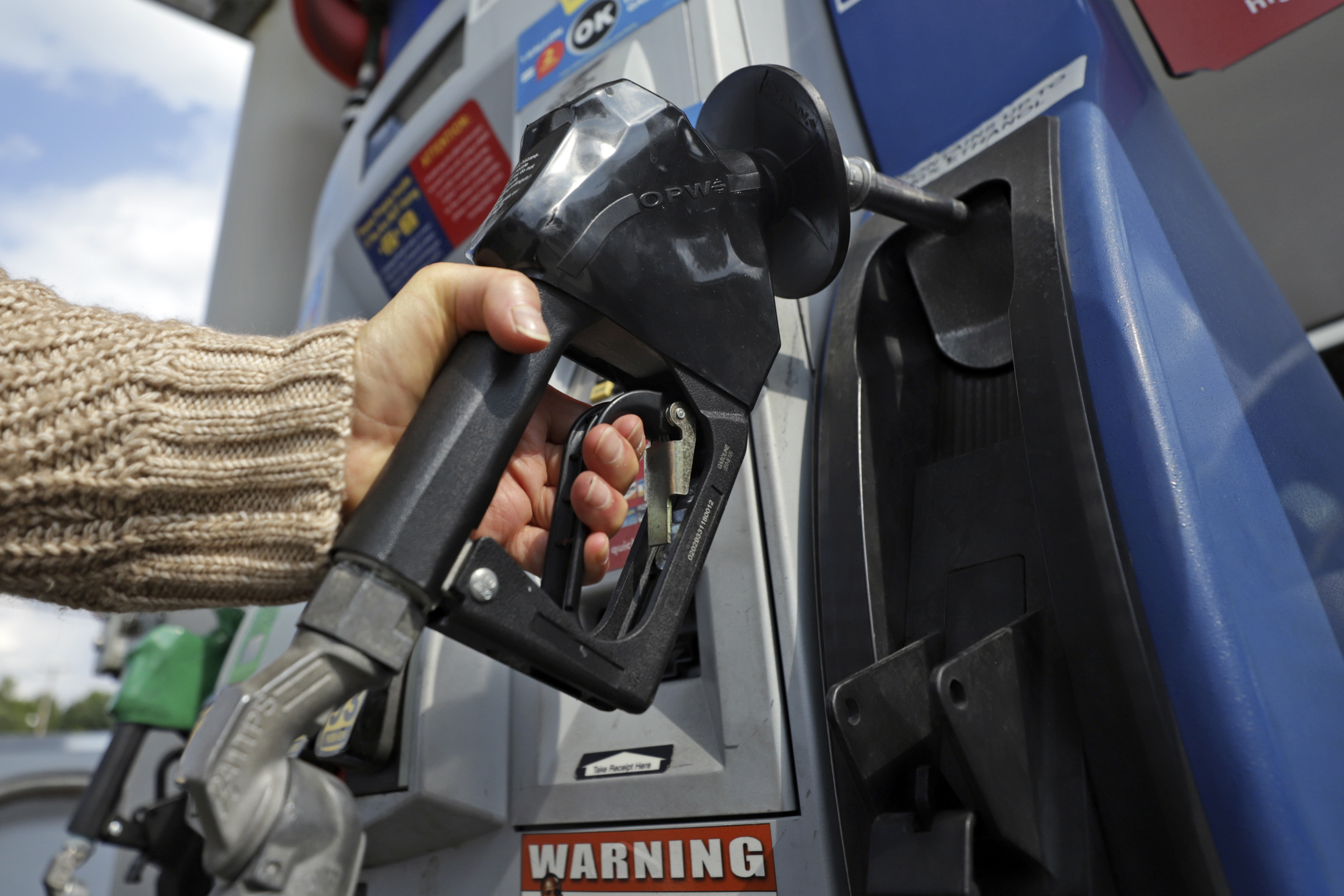 A woman pumps gas at a gas pump at a convenience store in Pittsburgh Monday, Sept. 16, 2019. Gas prices in the U.S. are already increasing.