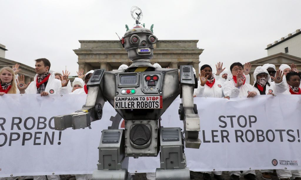 People take part in a demonstration as part of the campaign  Stop Killer Robots  organised by German NGO  Facing Finance  to ban what they call killer robots on March 21, 2019 in front of the Brandenburg Gate in Berlin.