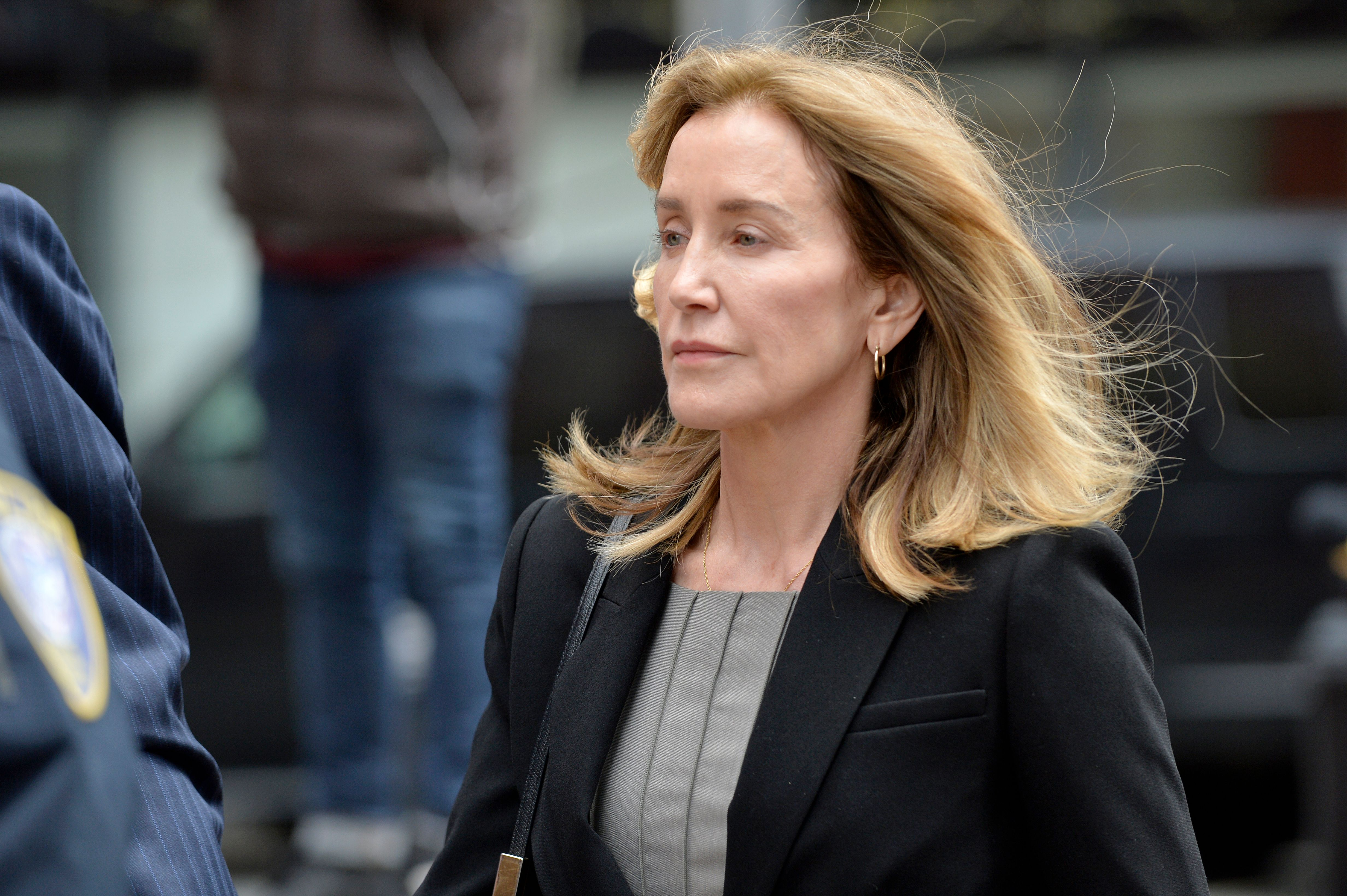 Actress Felicity Huffman is escorted into court on May 13, 2019.