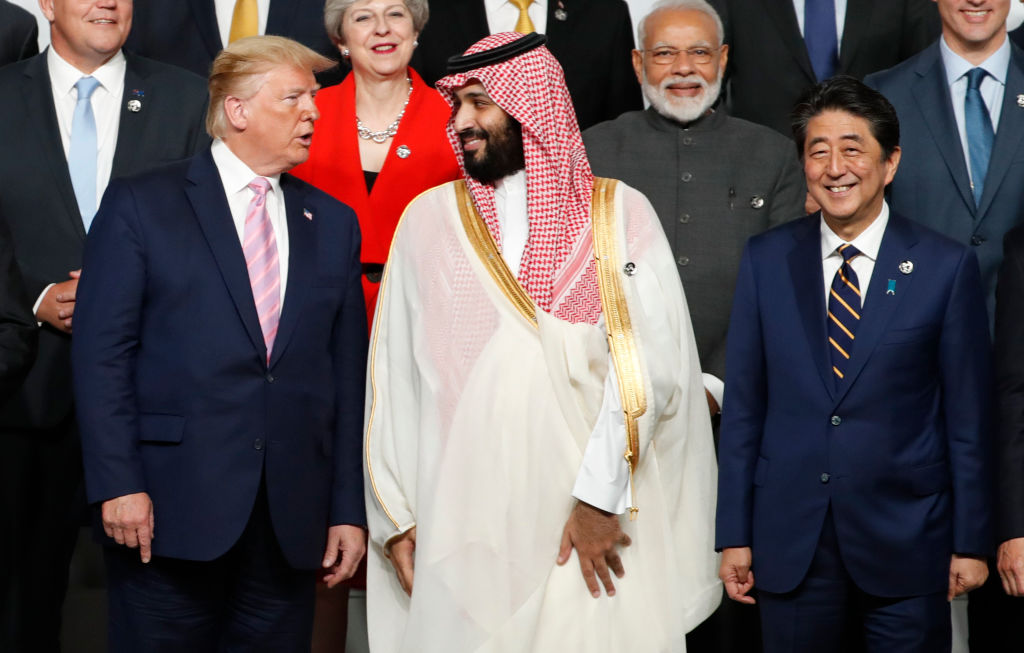 U.S. President Donald Trump speaks with Saudi Arabia's Crown Prince Mohammed bin Salman during a family photo session at G20 summit on June 28, 2019 in Osaka, Japan. President Trump offered U.S. support for Saudi Arabia's self-defense in a call on Saturday with Prince Salman, the White House said