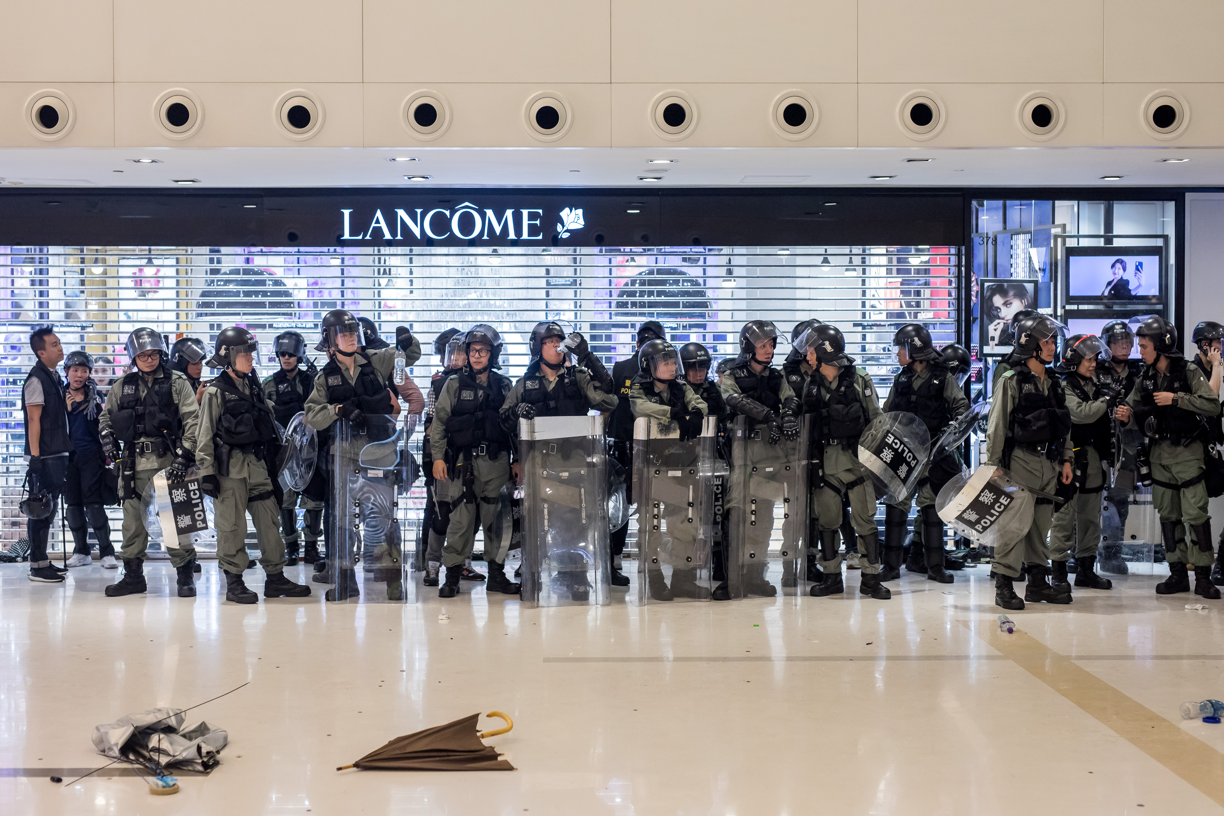 Riot police stand off against demonstrators inside New Town Plaza shopping mall, operated by Sun Hung Kai Properties Ltd., during a protest in the Shatin district of Hong Kong, China, on Sunday, July 14, 2019.