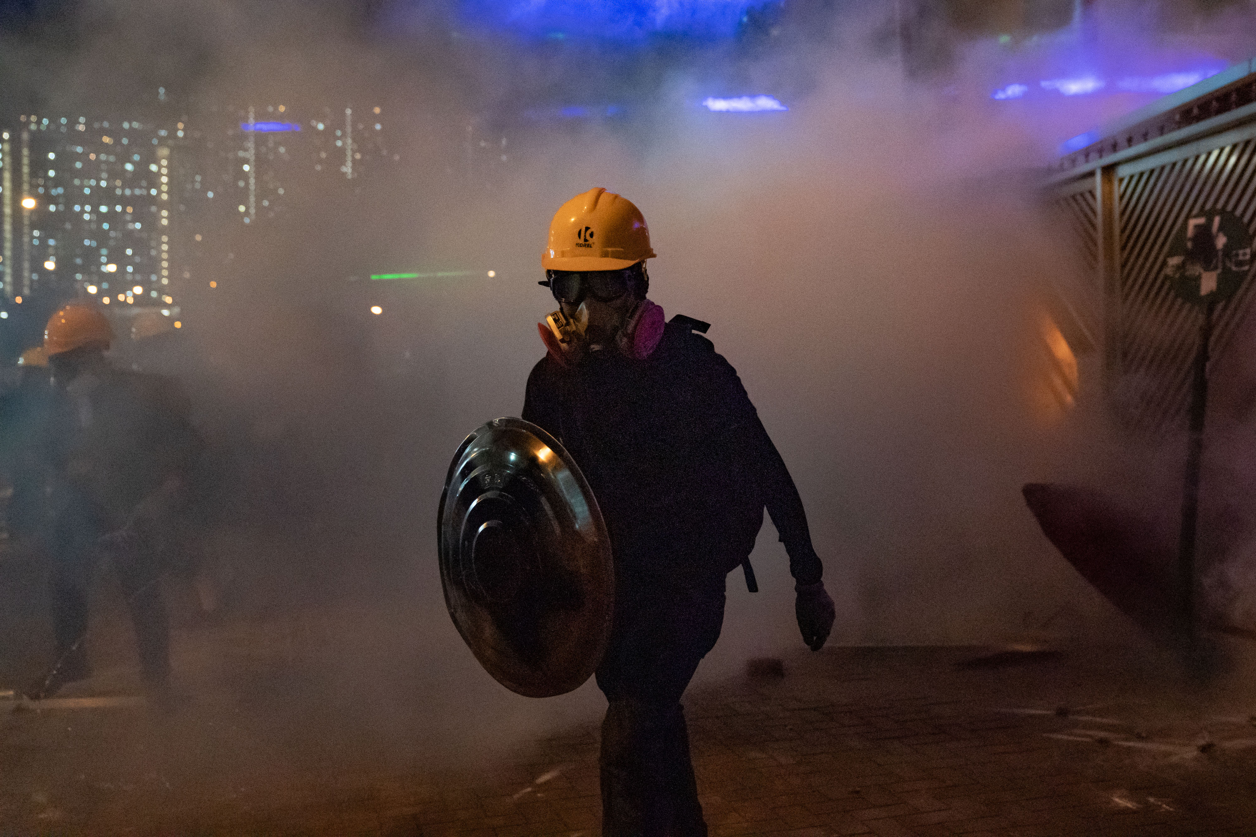Protesters stand off with police in a pall of tear gas during a demonstration on August 5, 2019 in Hong Kong