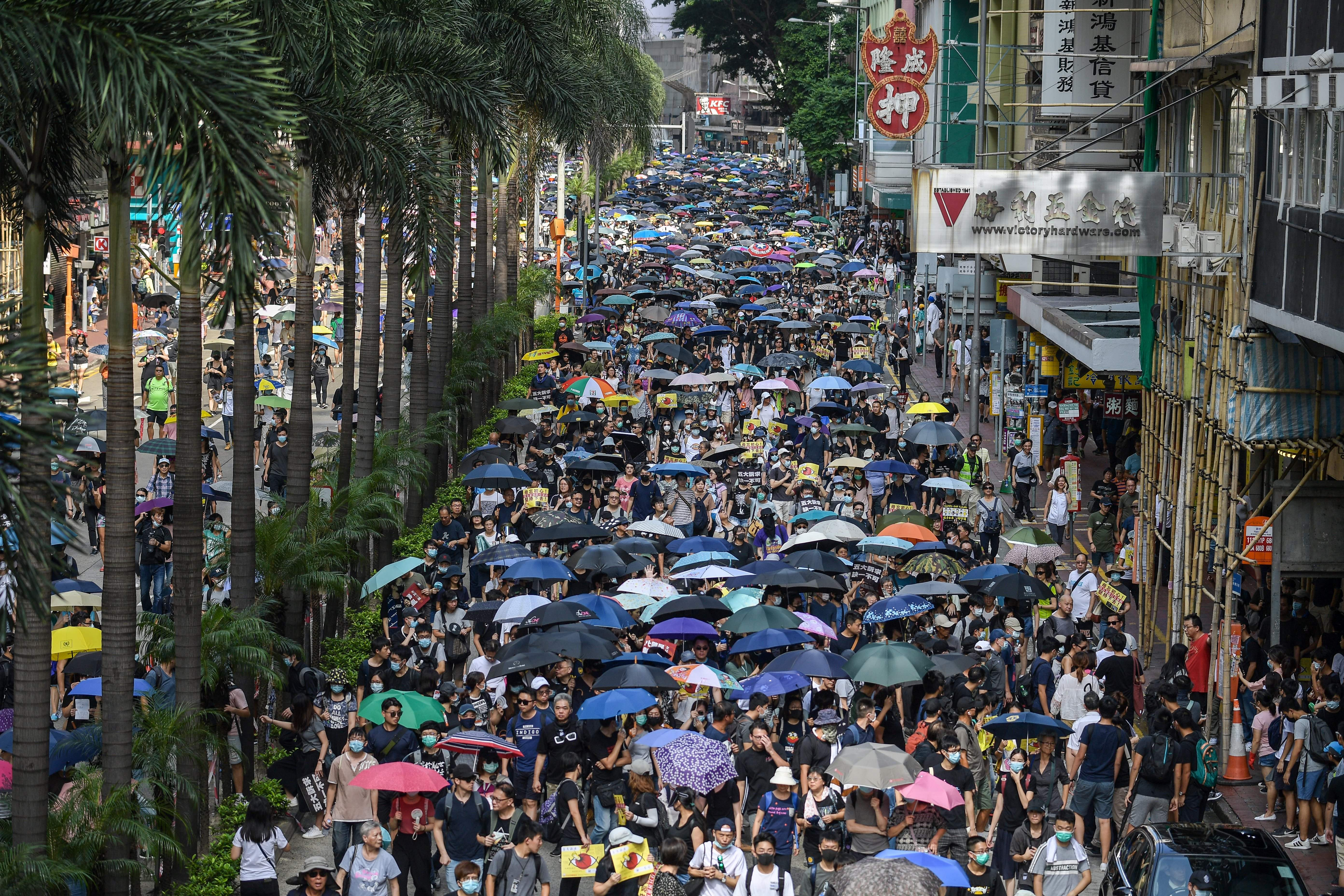 Protesters attend a pro-democracy march in Hong Kong on September 15, 2019.