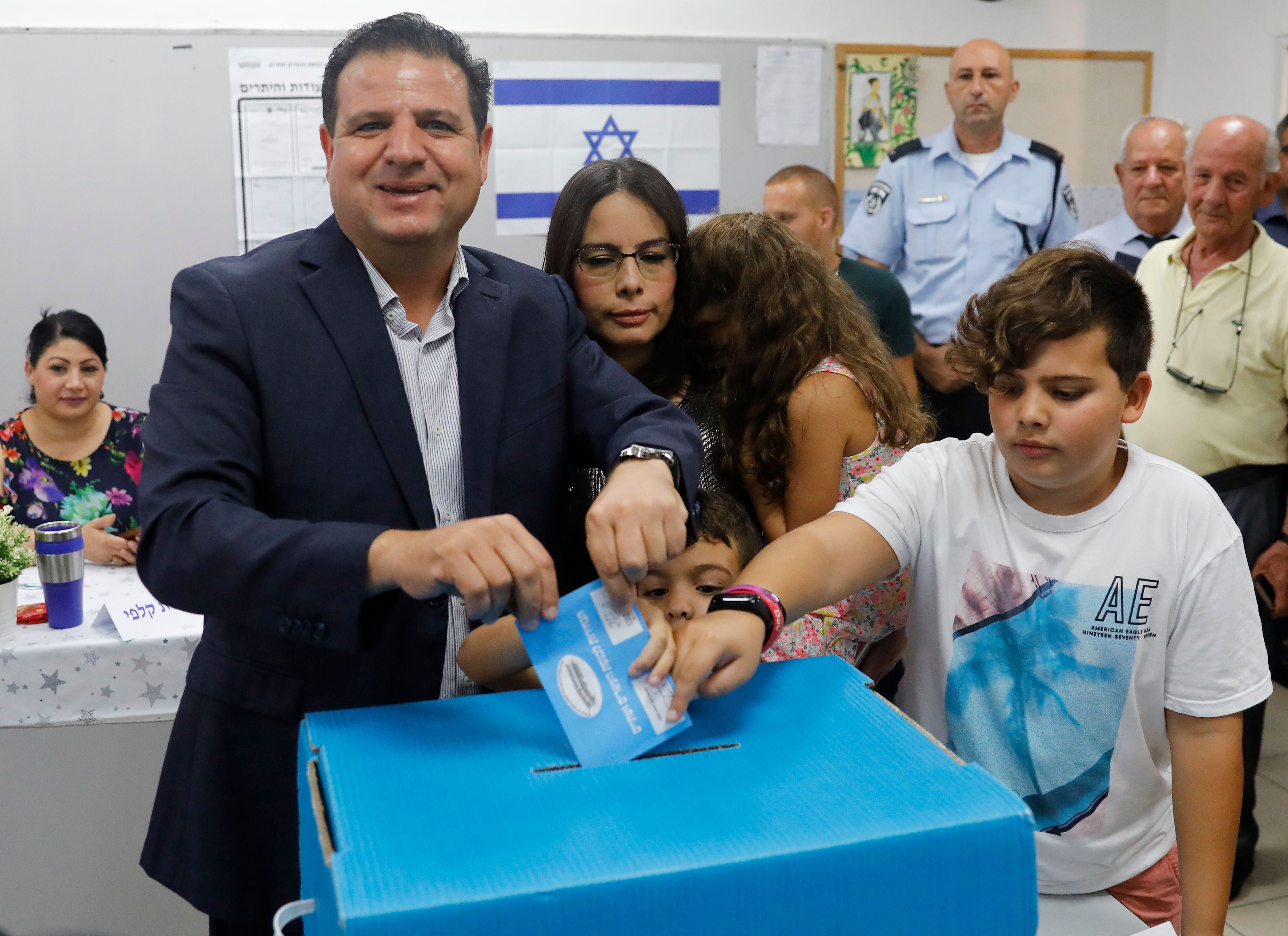 Israel's head of the mainly Arab Joint List alliance Ayman Odeh casts his ballot accompanied by his family during Israel's parliamentary election at a polling station in Haifa on September 17, 2019.