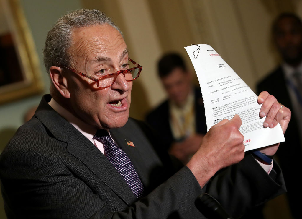 U.S. Senate Minority Leader Chuck Schumer (D-NY) holds up a copy of a recently released transcript provided by the Trump administration of the phone call between U.S. President Donald Trump and the Ukrainian President while speaking about the start of an impeachment inquiry at the U.S. Capitol on September 25, 2019 in Washington, DC.
