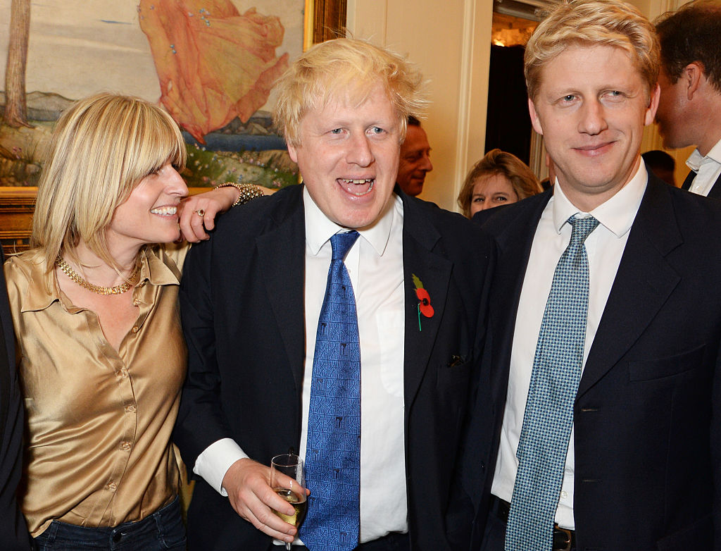 (L to R) Rachel Johnson, Boris Johnson and Jo Johnson attend the launch of Boris Johnson's new book  The Churchill Factor: How One Man Made History  at Dartmouth House on October 22, 2014 in London, England.