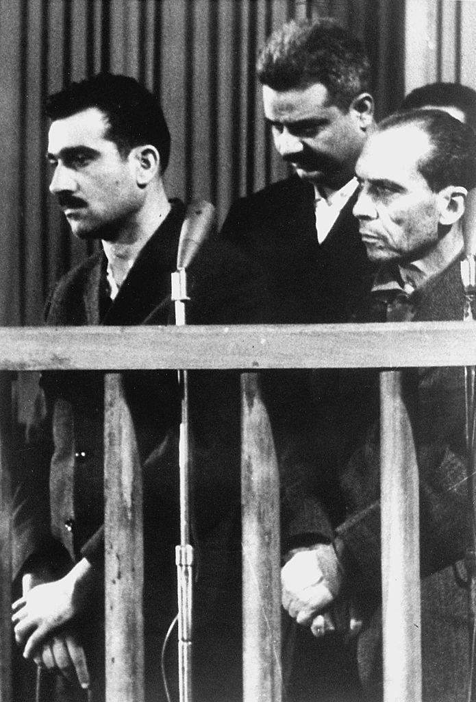 Israeli spy Eli Cohen (L) and two other unidentified co-defendants during their trial in Damascus, ten days before his execution.