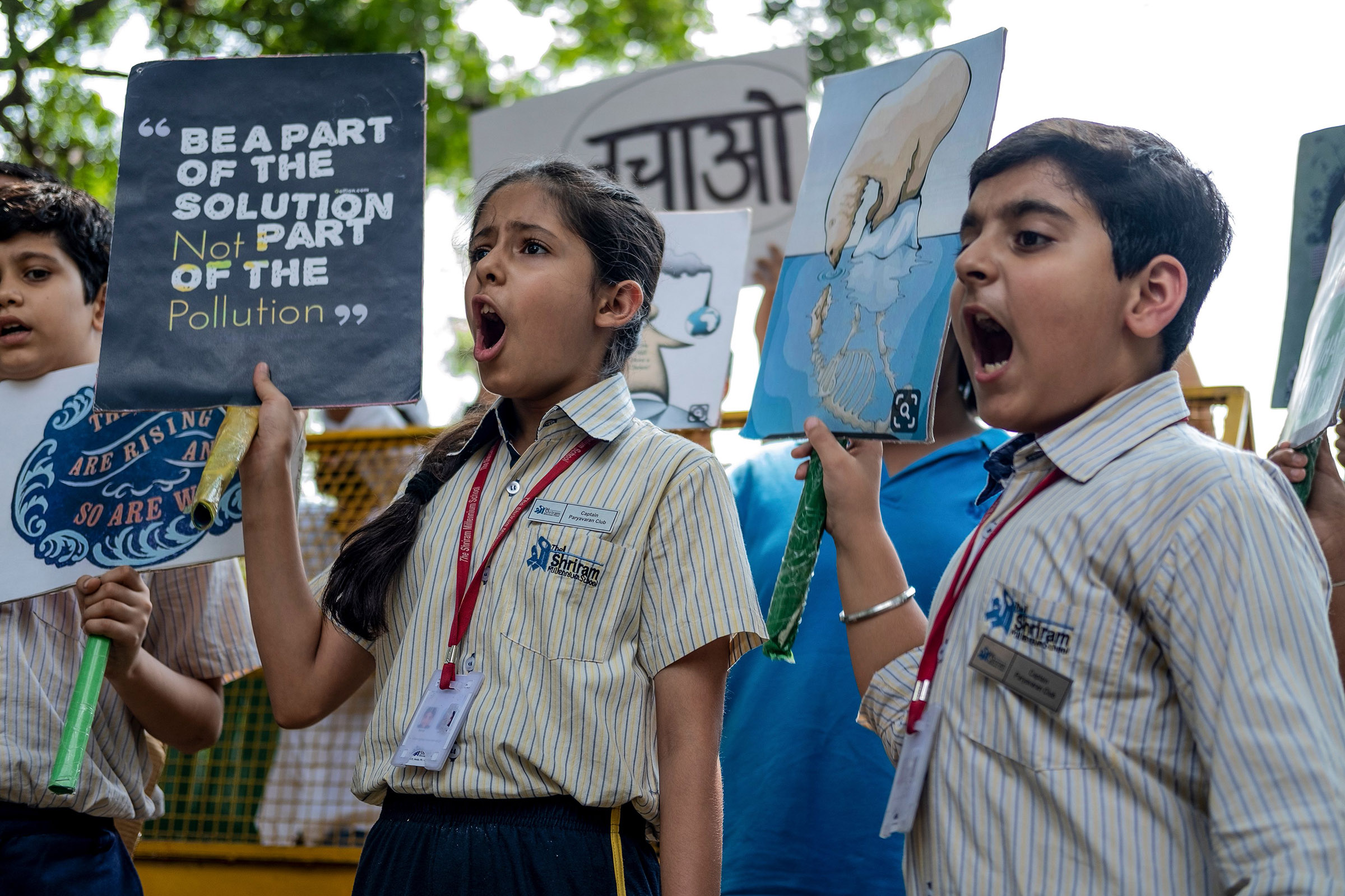 School children shout slogans as they participate in a climate strike to protest against governmental inaction towards climate breakdown and environmental pollution, part of demonstrations being held worldwide in a movement dubbed  Fridays for Future , in New Delhi on September 20, 2019.