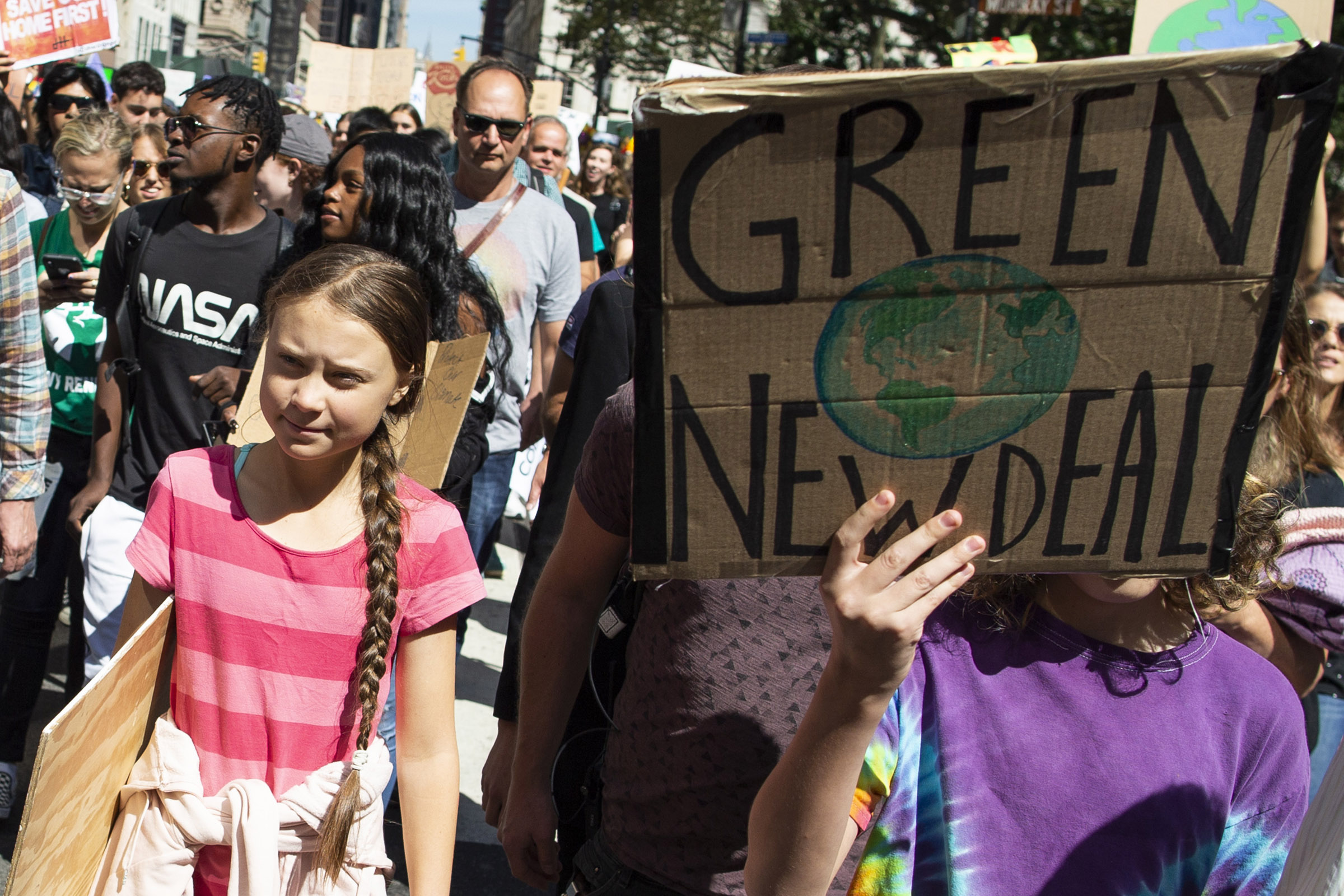 Swedish environmental activist Greta Thunberg, left, takes part during the Climate Strike, Friday, Sept. 20, 2019 in New York.