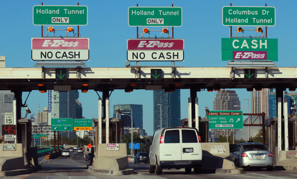 Cars pass through a toll plaza on the New Jersey Turnpike on August 29, 2019 in Jersey City, New Jersey.  Unless the federal government starts making major investments, the dire infrastructure needs of our nation will only get worse, says Reps. Nita M. Lowey and David E. Price.