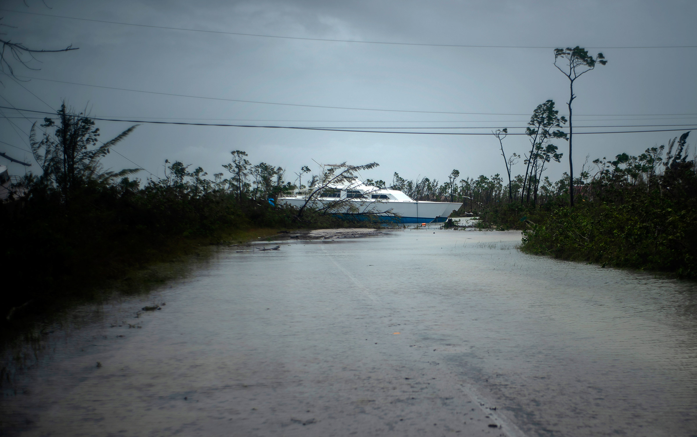 A catamaran thrown onshore by the hurricane lies stranded near a highway close to Freeport, Grand Bahama, Bahamas, on Sept. 3, 2019.