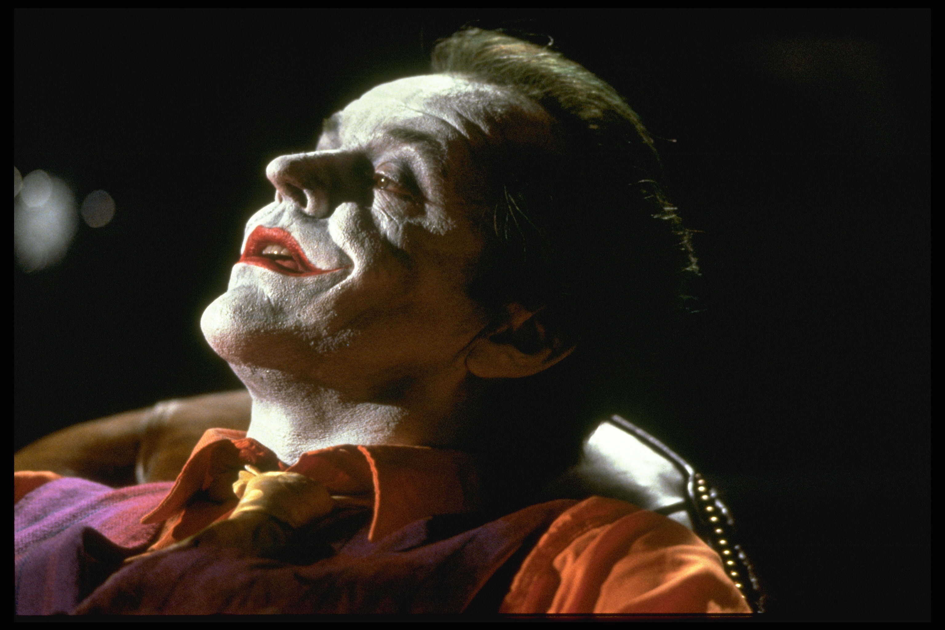 Jack Nicholson plays the Joker in the movie Batman, directed by Tim Burton