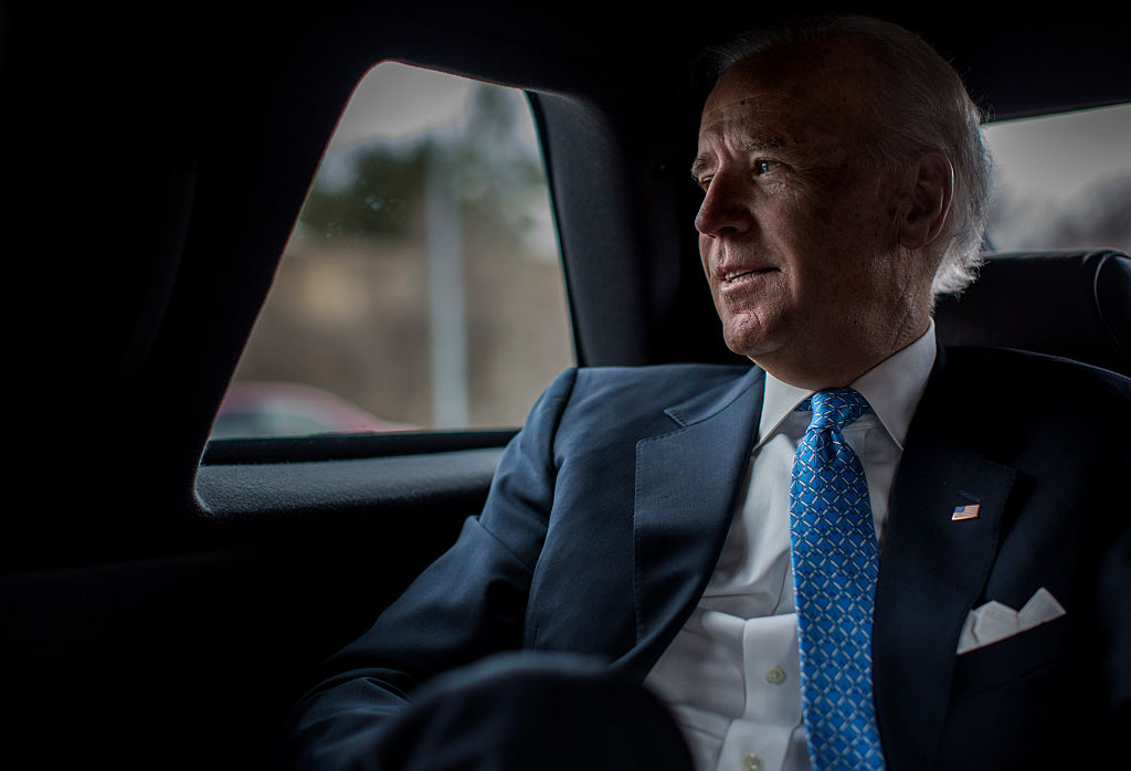 Contemplatively looks out the car window during a planning meeting with staff, Vice President Joe Biden is driven back to the White House after speaking to lawmakers, woman against violence advocates, and constituents concerning reducing domestic violence homicides in Rockville, Md., on March 13, 2013.