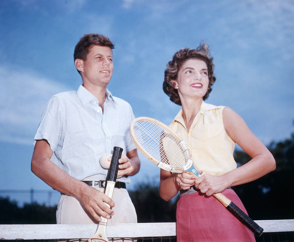 Senator John Kennedy and his fiancee Jacqueline Bouvier playing tennis in 1953.