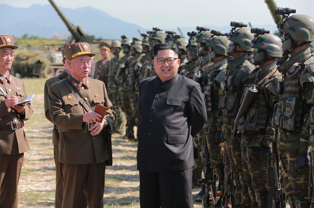 This undated photo released by North Korea's official Korean Central News Agency (KCNA) on Aug. 26, 2017 shows North Korean leader Kim Jong-Un (C) presiding over a target strike exercise conducted by the special operation forces of the Korean People's Army (KPA) at an undisclosed location.