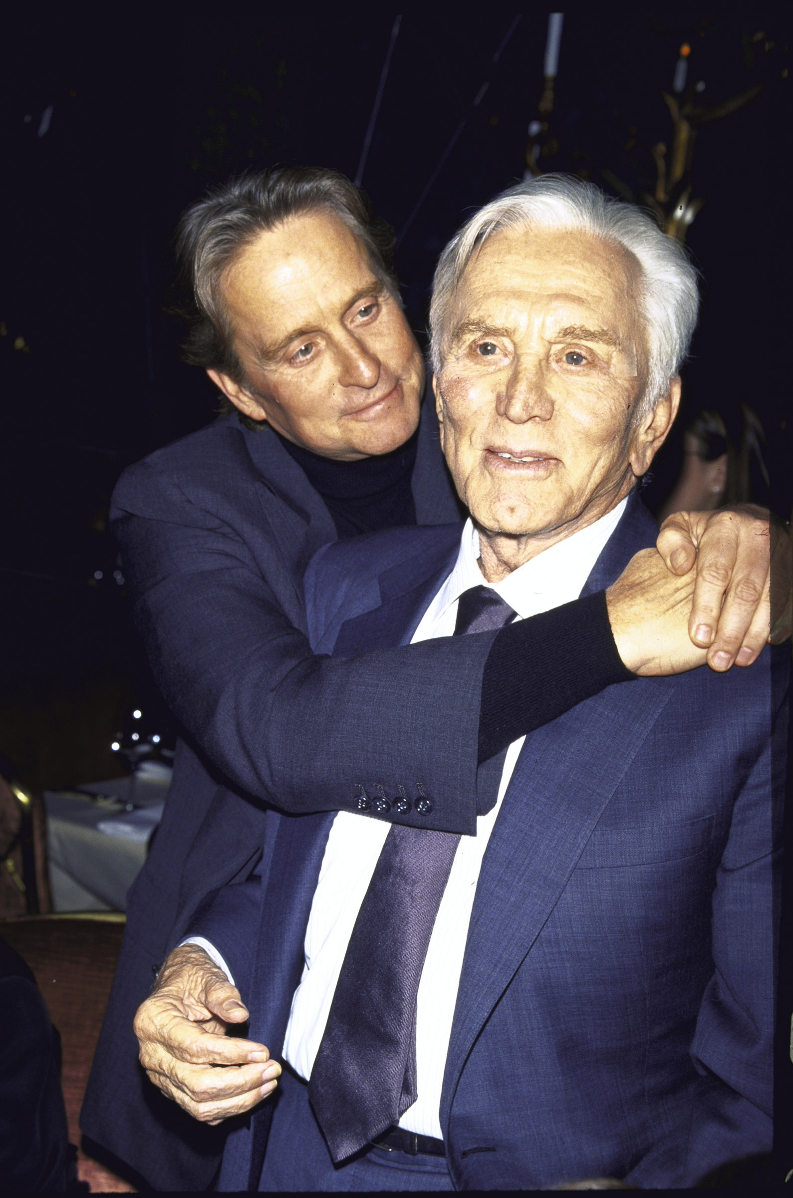 (L-R) Actor Michael Douglas and his father, actor Kirk Douglas, at a film premiere of Kirk's Diamonds in December 1999.