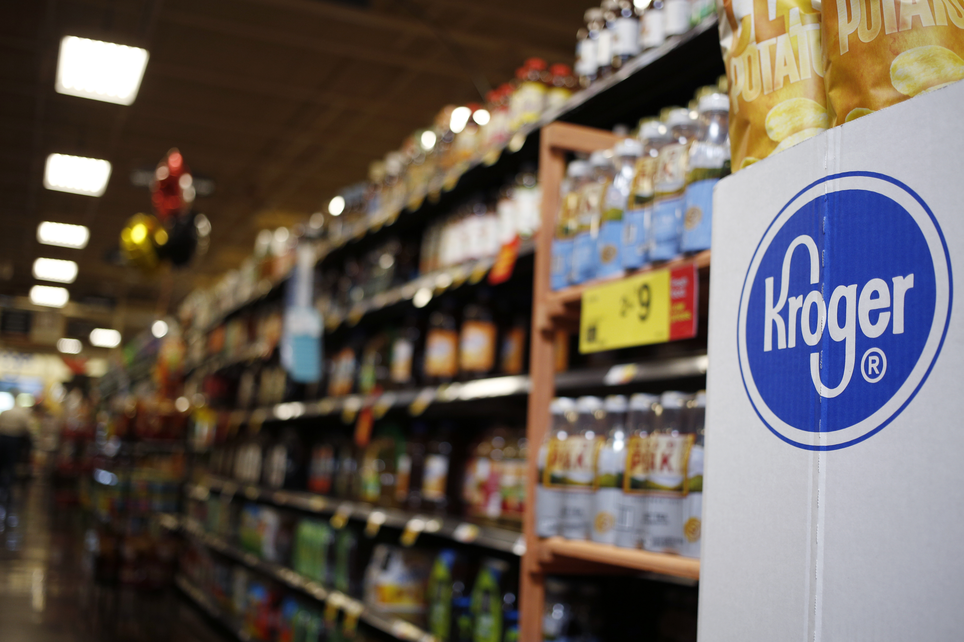 Signage is displayed inside a Kroger Co. grocery store in Louisville, Kentucky, U.S., on Wednesday, June 14, 2017.