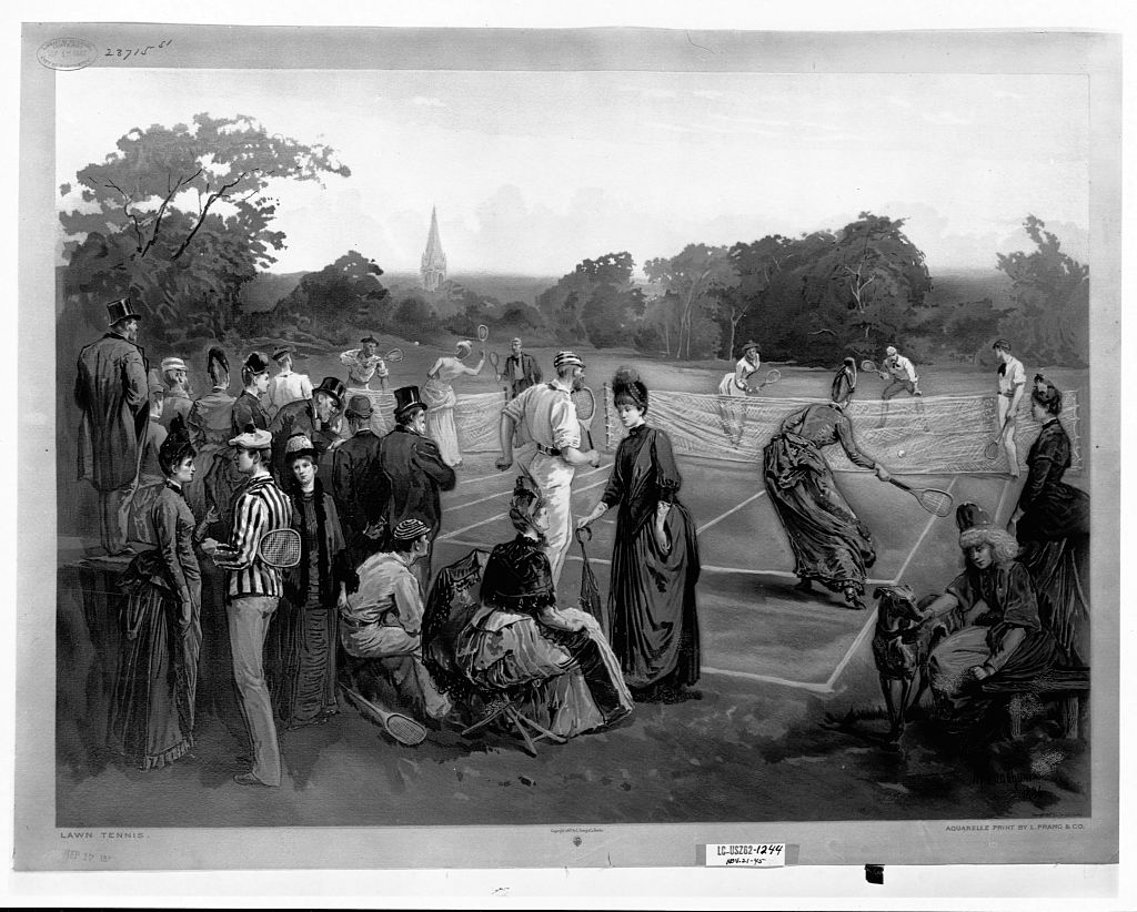 Men in suits and women in long dresses playing lawn tennis.