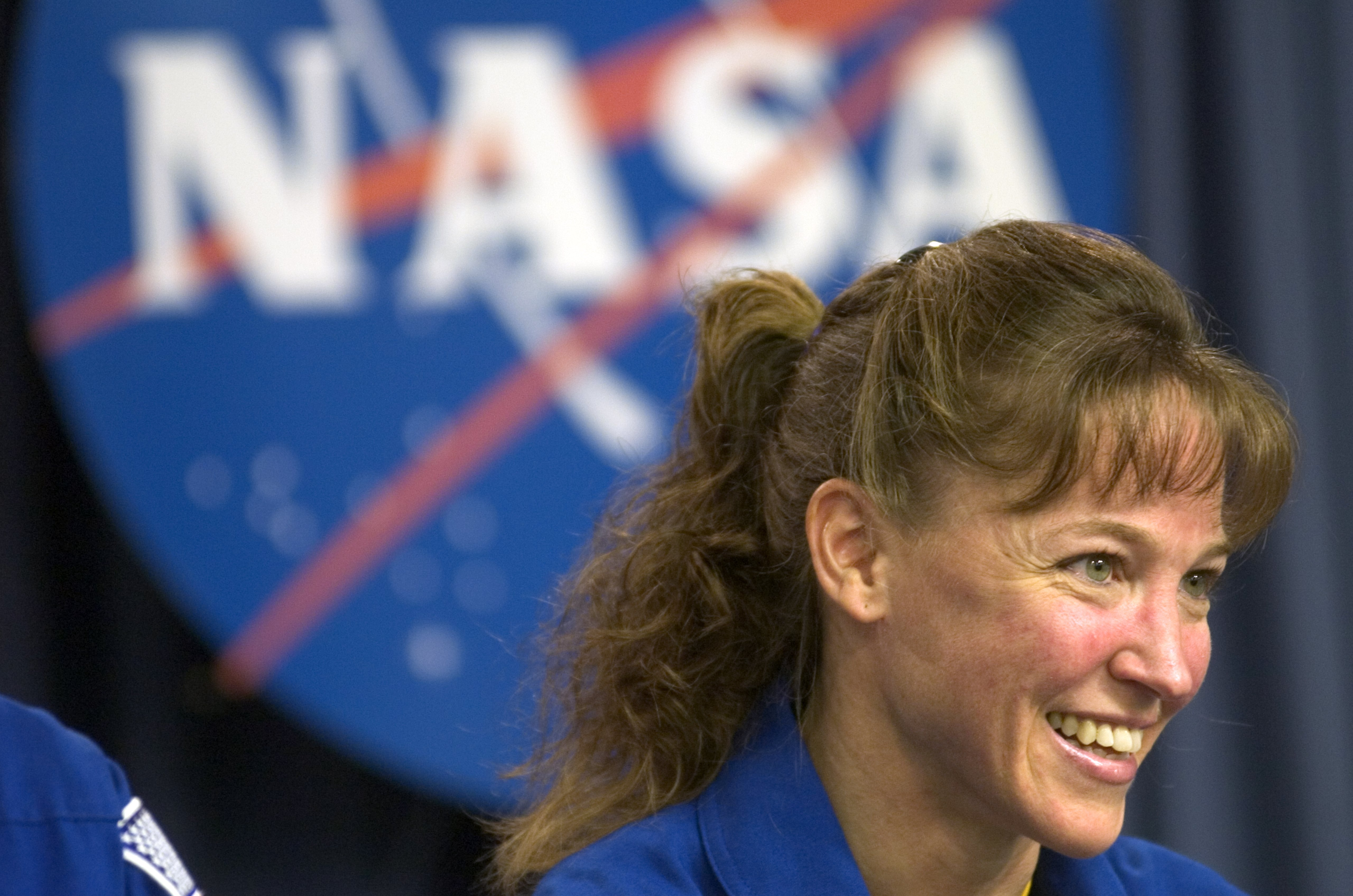 Mission Specialist Lisa Nowak speaks at a post mission press conference July 17, 2006 at Kennedy Space Center in Florida.