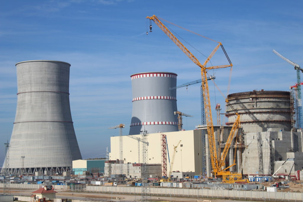 FILED - 10 October 2018, Belarus, Ostrowez: The cooling towers and a reactor block of the Ostrowez nuclear power plant. Just a few kilometres from the border with Lithuania and thus with the EU, the first Belarusian nuclear power plant is due to start operation in 2019. Photo: Claudia Thaler/dpa (Photo by /picture alliance via Getty Images)