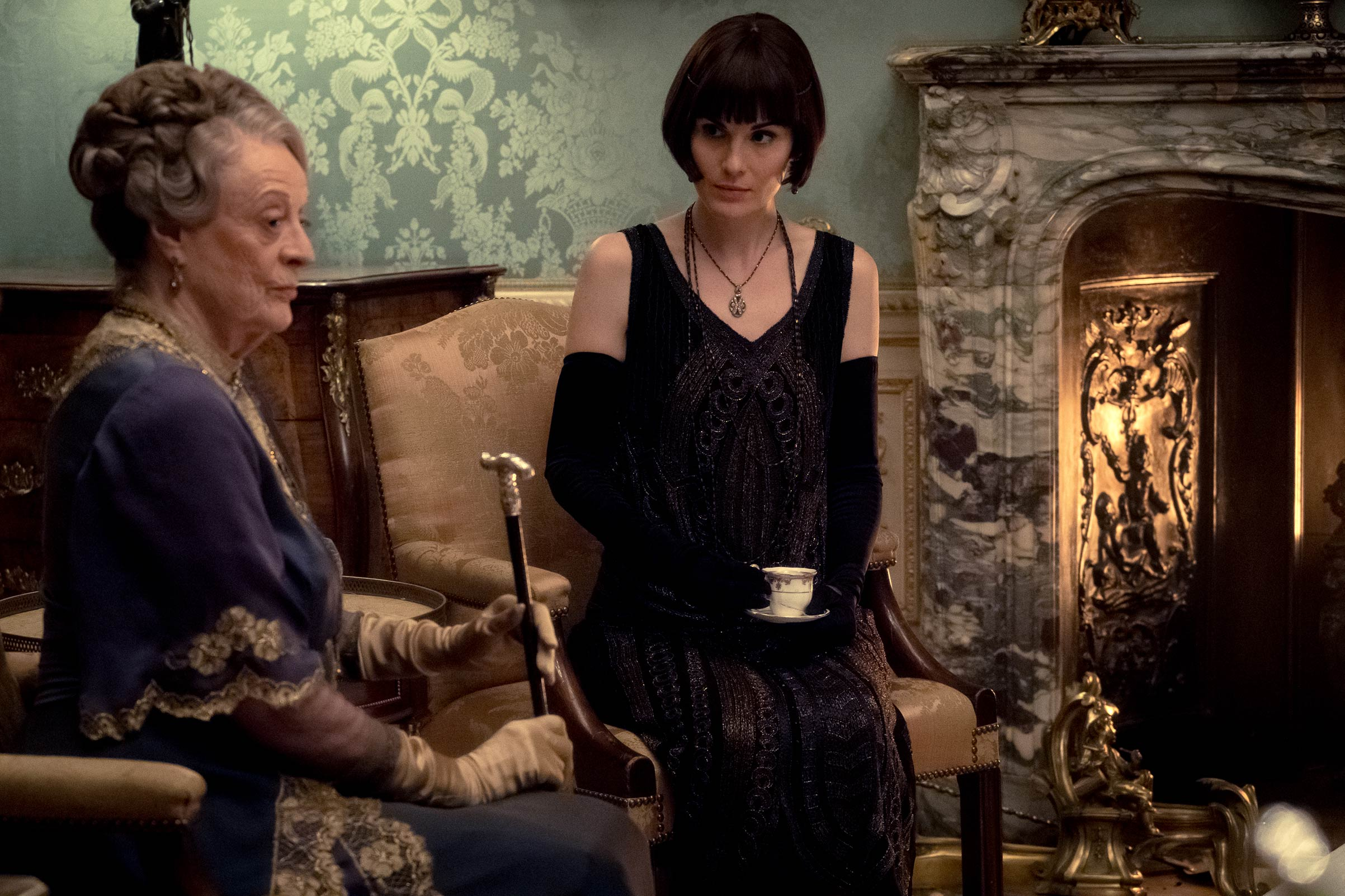 Maggie Smith (left) stars as Violet Crawley and Michelle Dockery as Lady Mary in the 2019 movie Downton Abbey.