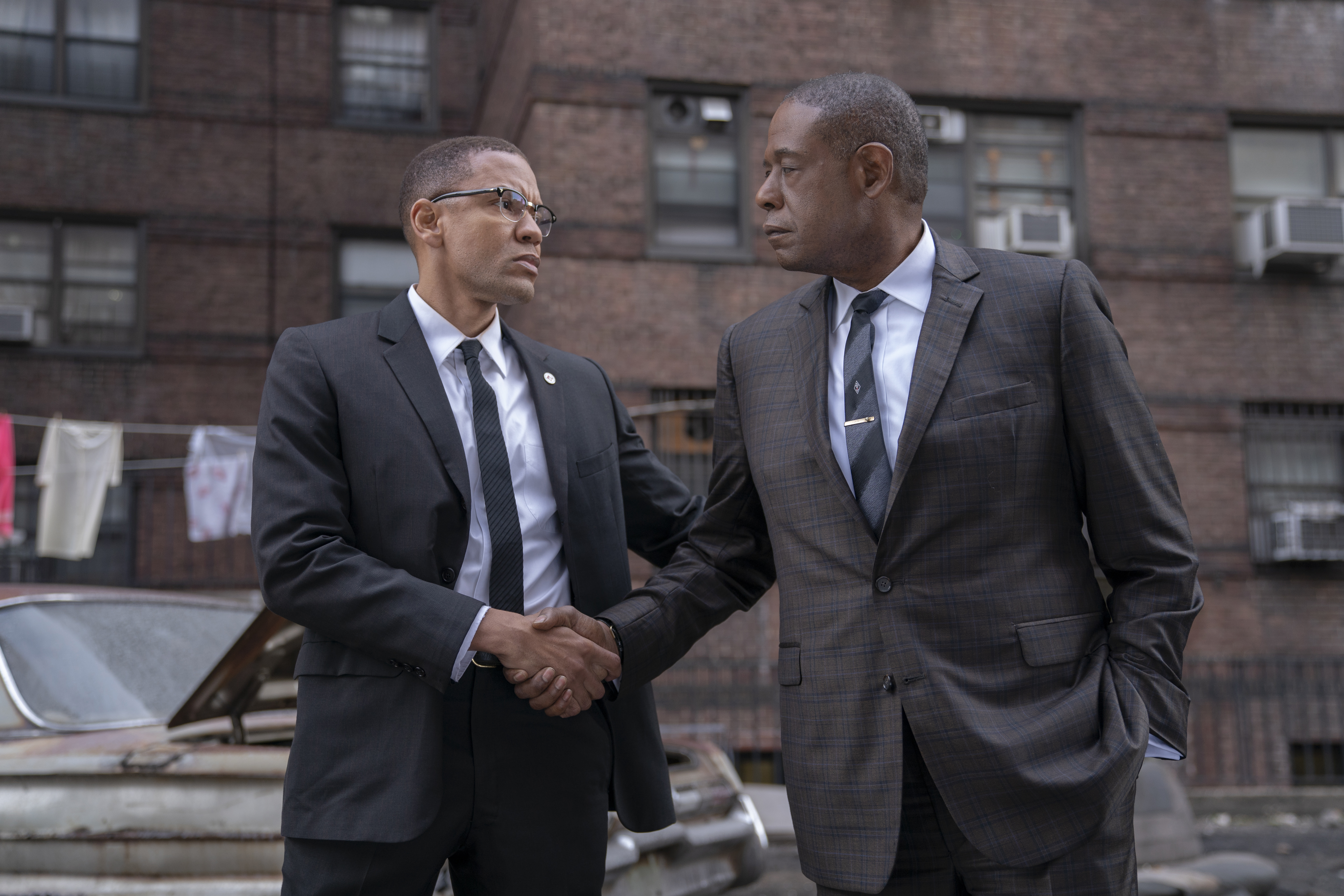 Malcolm X (Nigél Thatch) and Johnson (Forest Whitaker) make a deal.