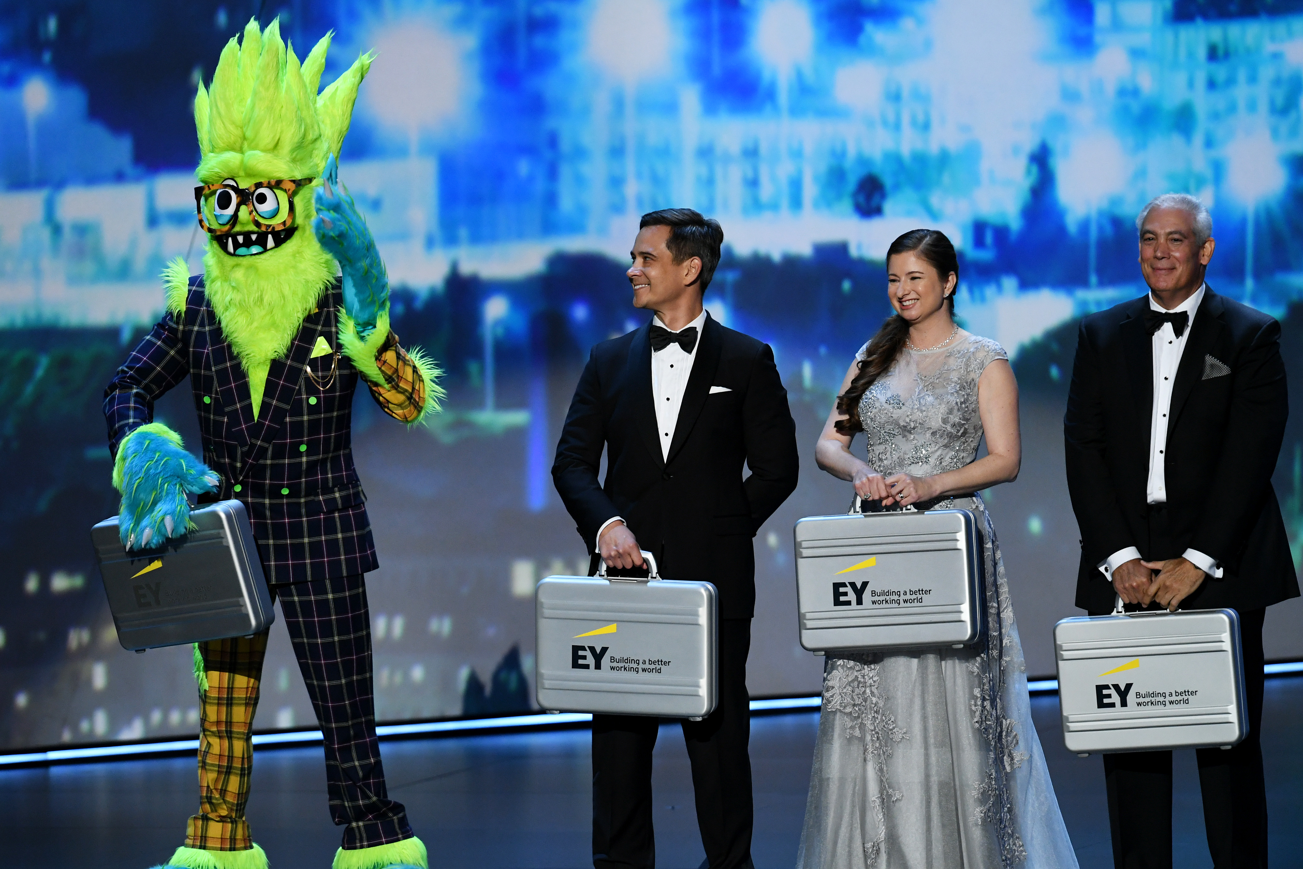 A character from 'The Masked Singer' and Ernst & Young representatives appear onstage during the 71st Emmy Awards.