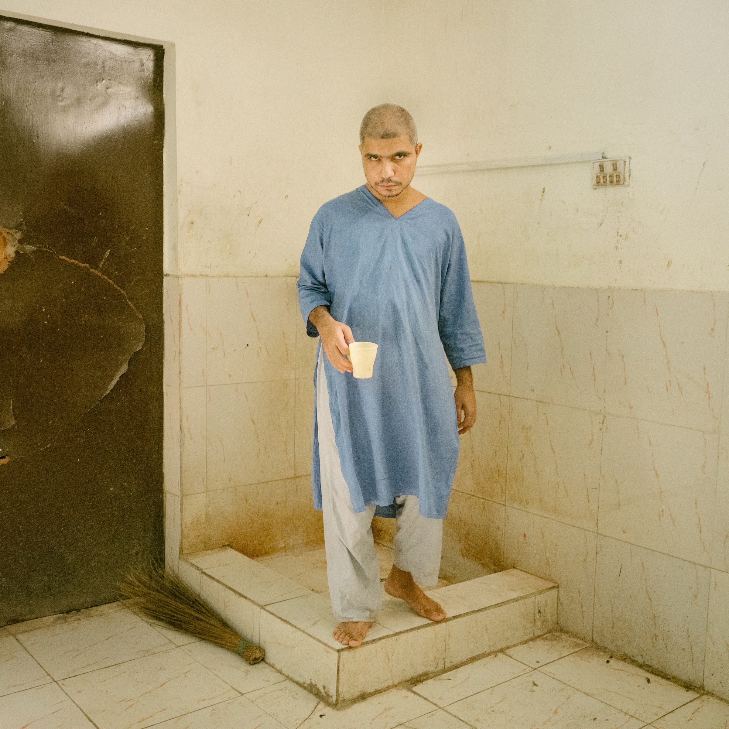 A patient retrieves water at a mental asylum in Hyderabad, south of Jacobabad, on July 2.