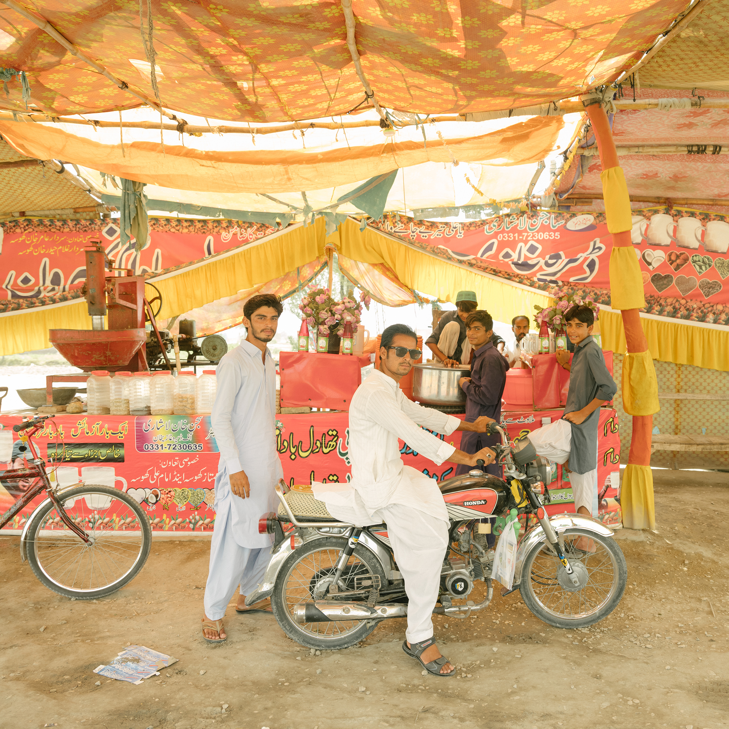 Customers at a roadside shop selling thadel on the outskirts of Jacobabad on June 27.