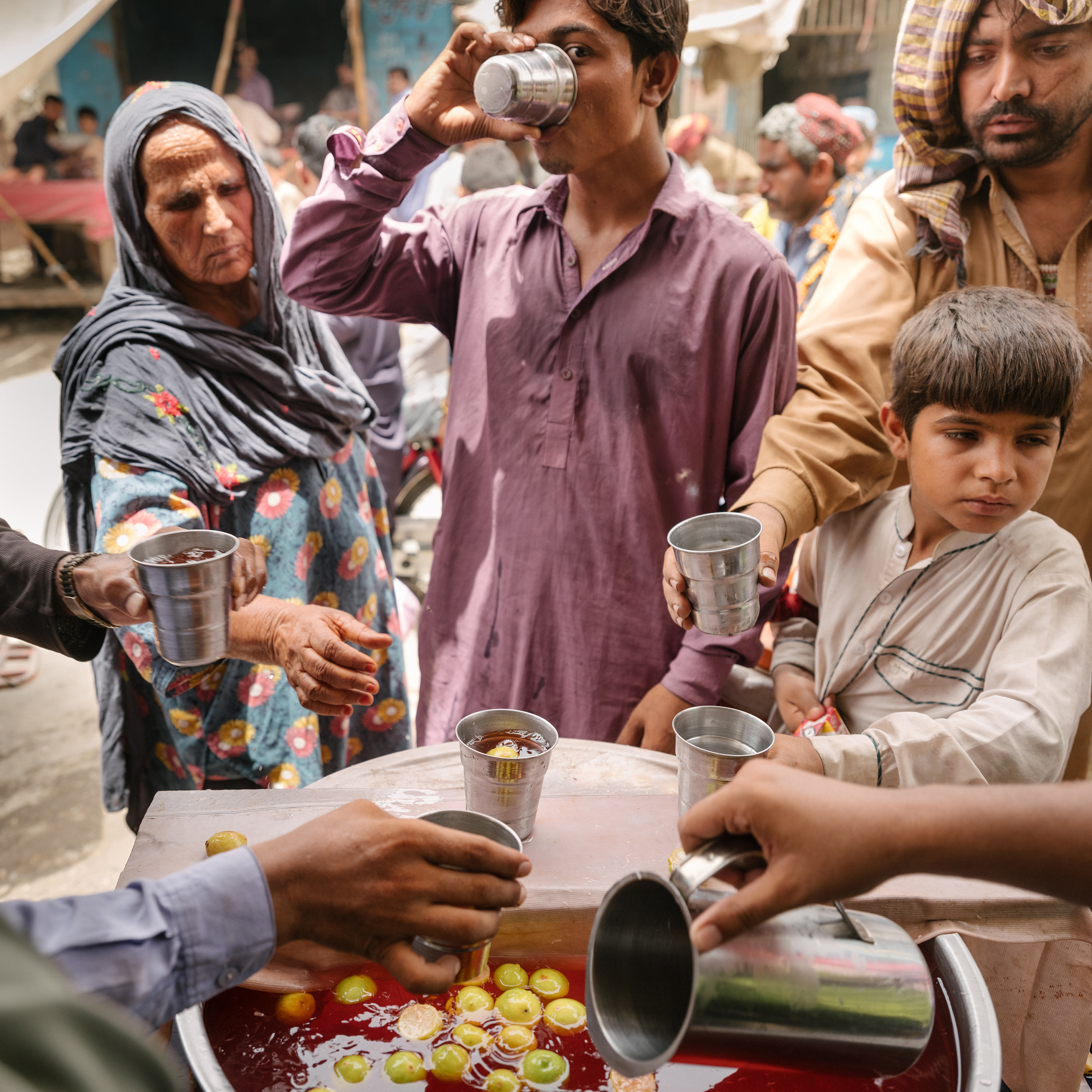 Police in Jacobabad serve punch to locals, to prevent heatstroke on the hottest days.