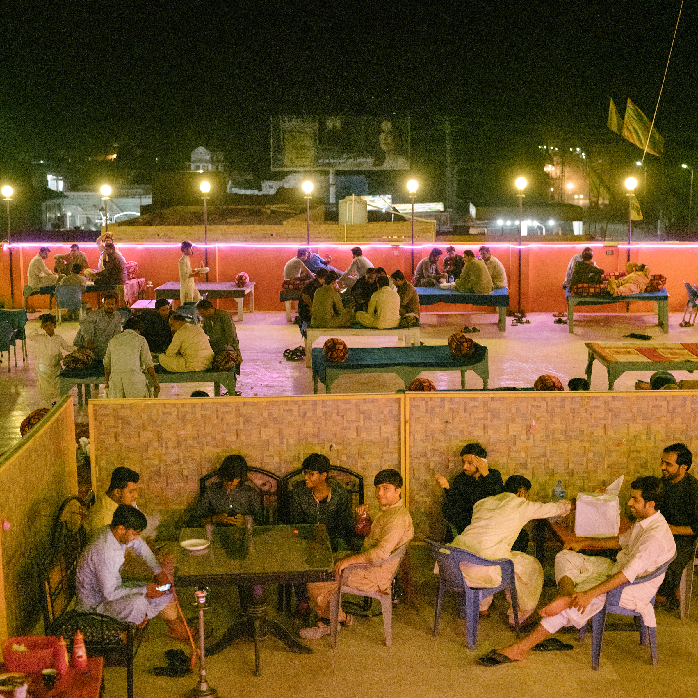 Outdoor restaurants, like this one in Jacobabad on June 27, are only open after sunset. Patrons may stay late into the night.