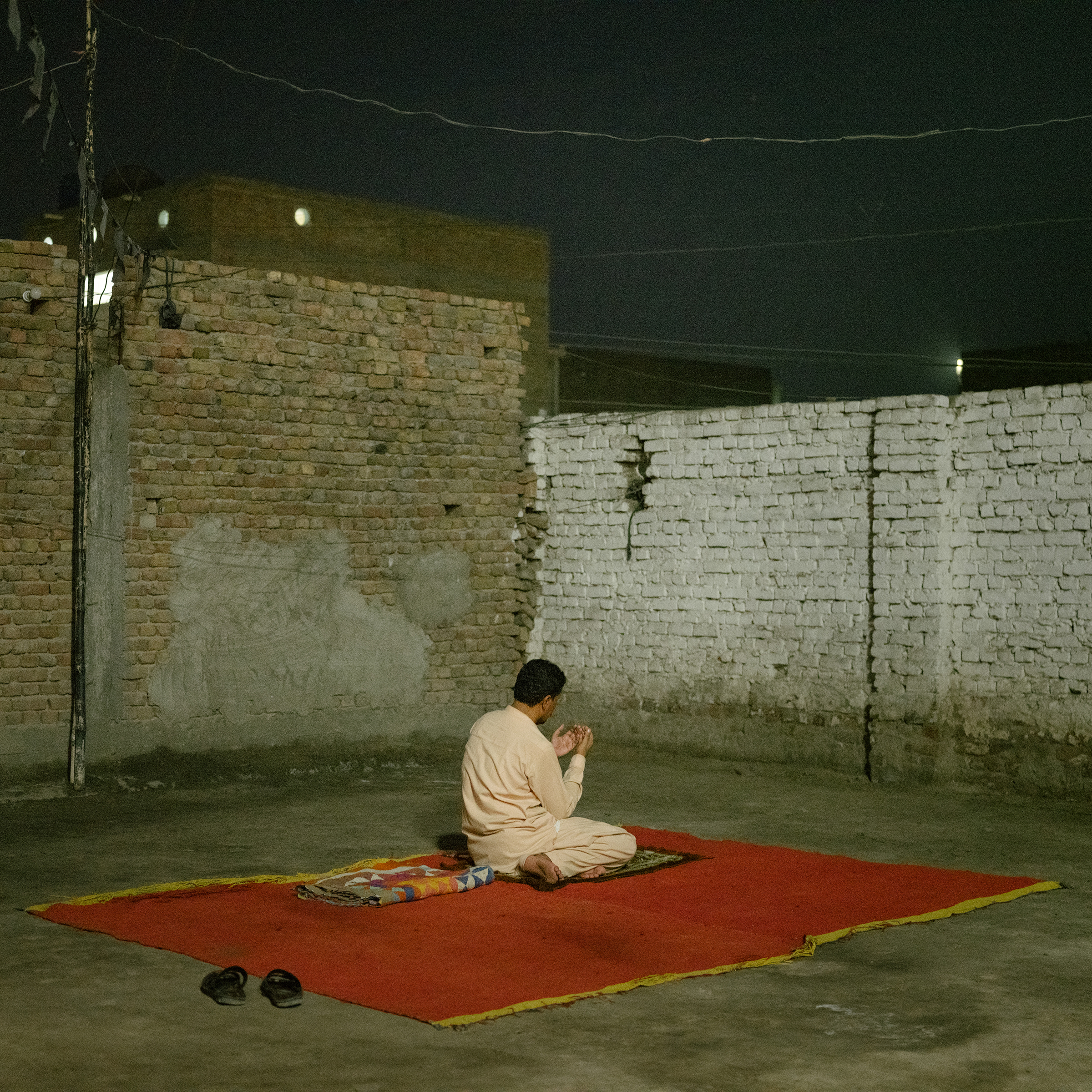 A man performs evening prayers in the city center of Jacobabad on June 27.